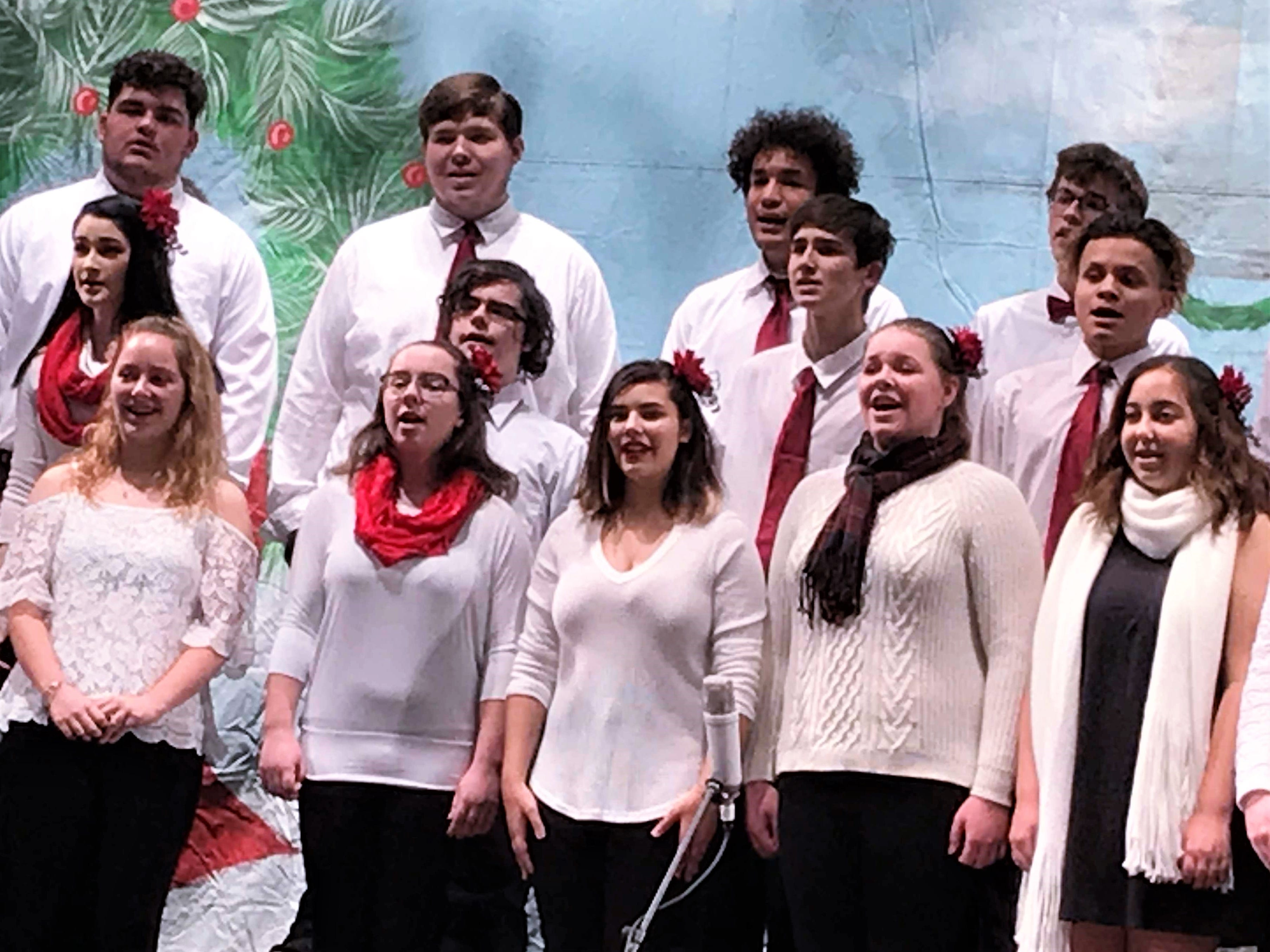 Members of the Elmira High School choral group perform during Sunday's annual Arctic League broadcast.