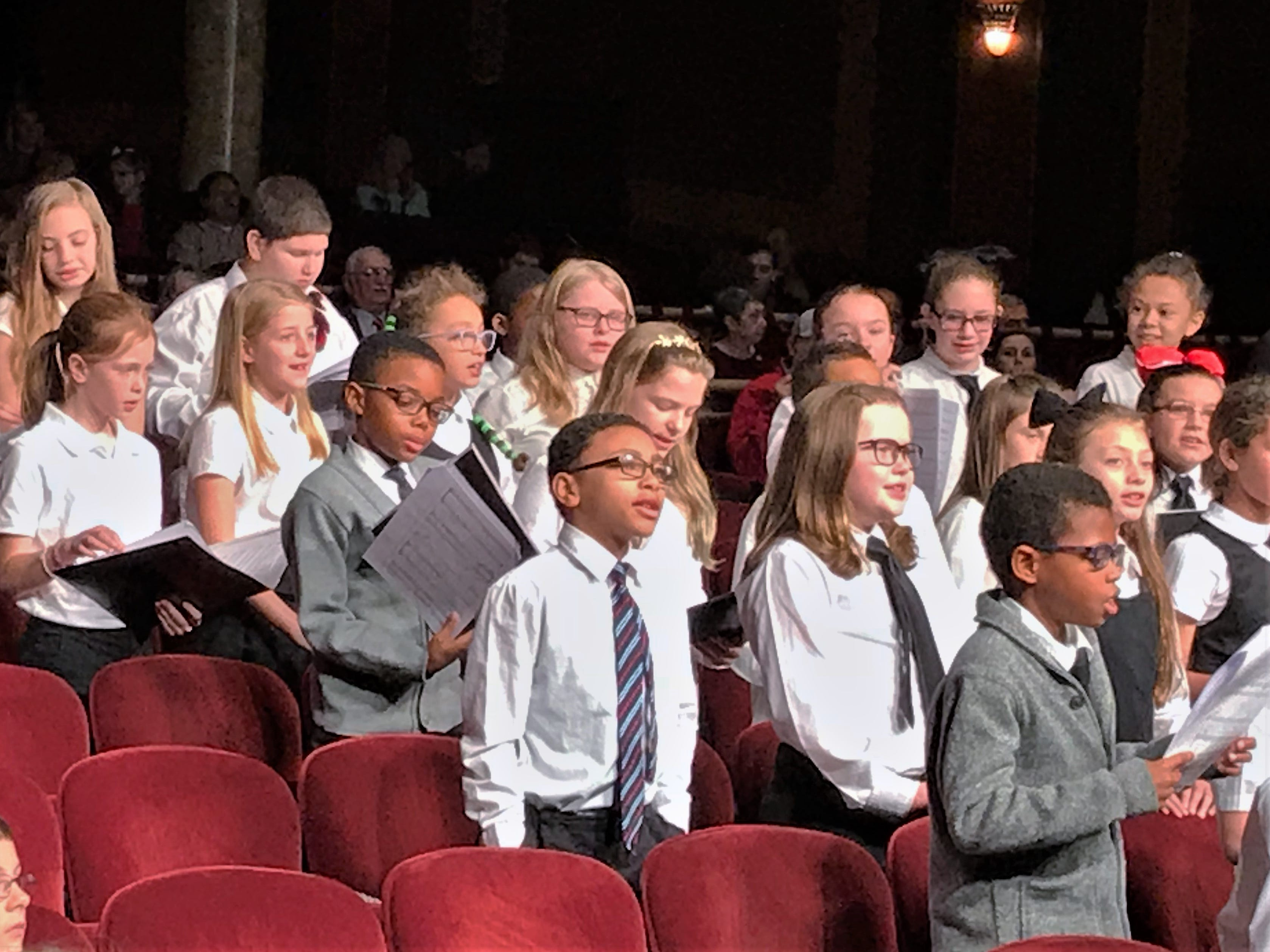 Finn Academy students perform a Christmas song during Sunday's Arctic League broadcast from the Clemens Center.