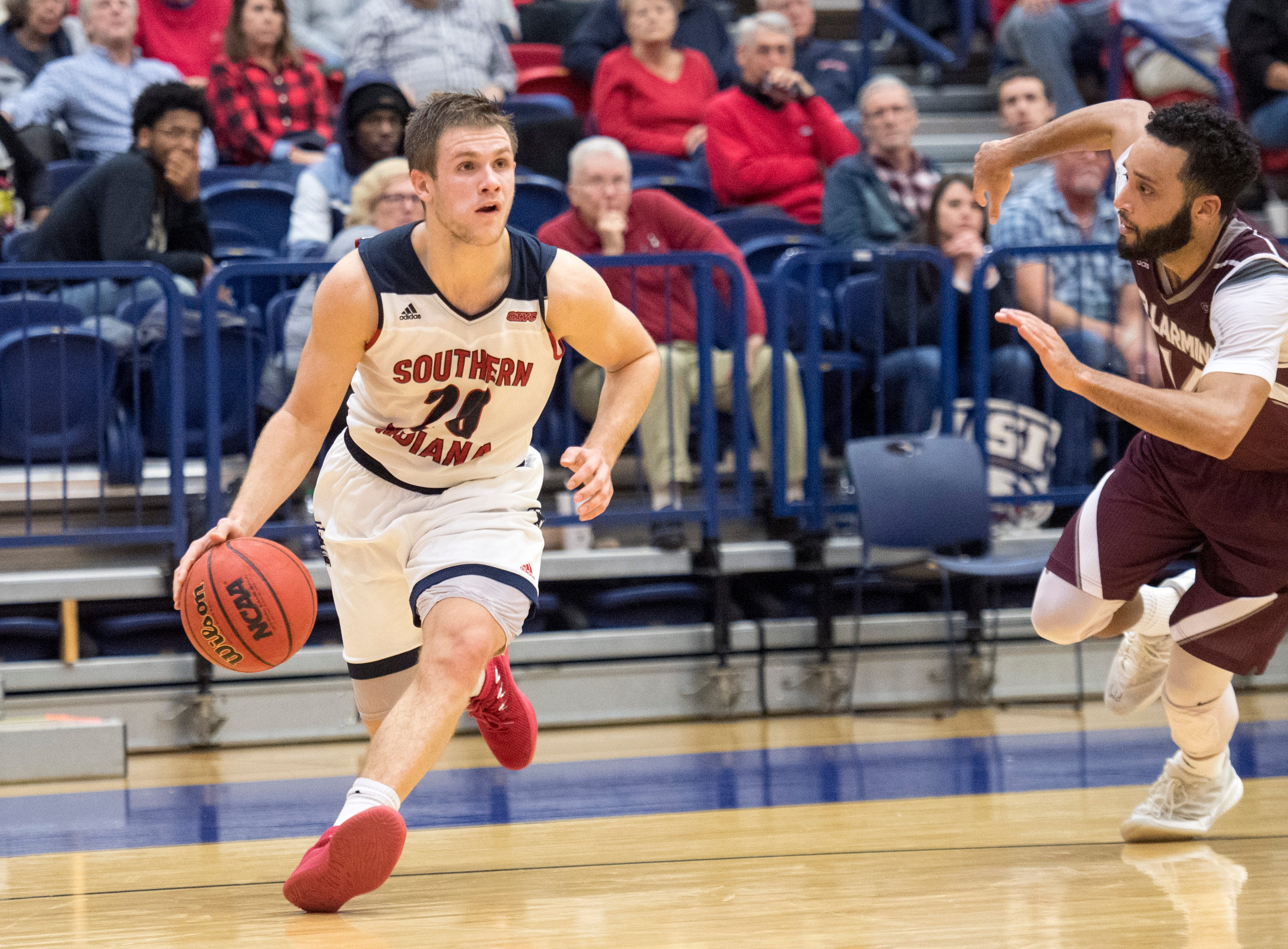 USI's Alex Stein (20) dribbles the ball pass Bellarmine defense during the USI vs Bellarmine game at the PAC Saturday, Dec. 1, 2018.