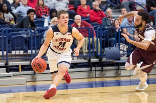 USI's Alex Stein dribbles past a Bellarmine defender during the Eagles' 92-80 loss Dec. 1 at the PAC. The Eagles ended Bellarmine's 67-game home-court winning streak, 80-76, on Feb. 2.