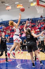 USI's Mikayla Rowan (40) soars toward the basket during the USI vs Bellarmine game at the PAC Saturday, Dec. 1, 2018.