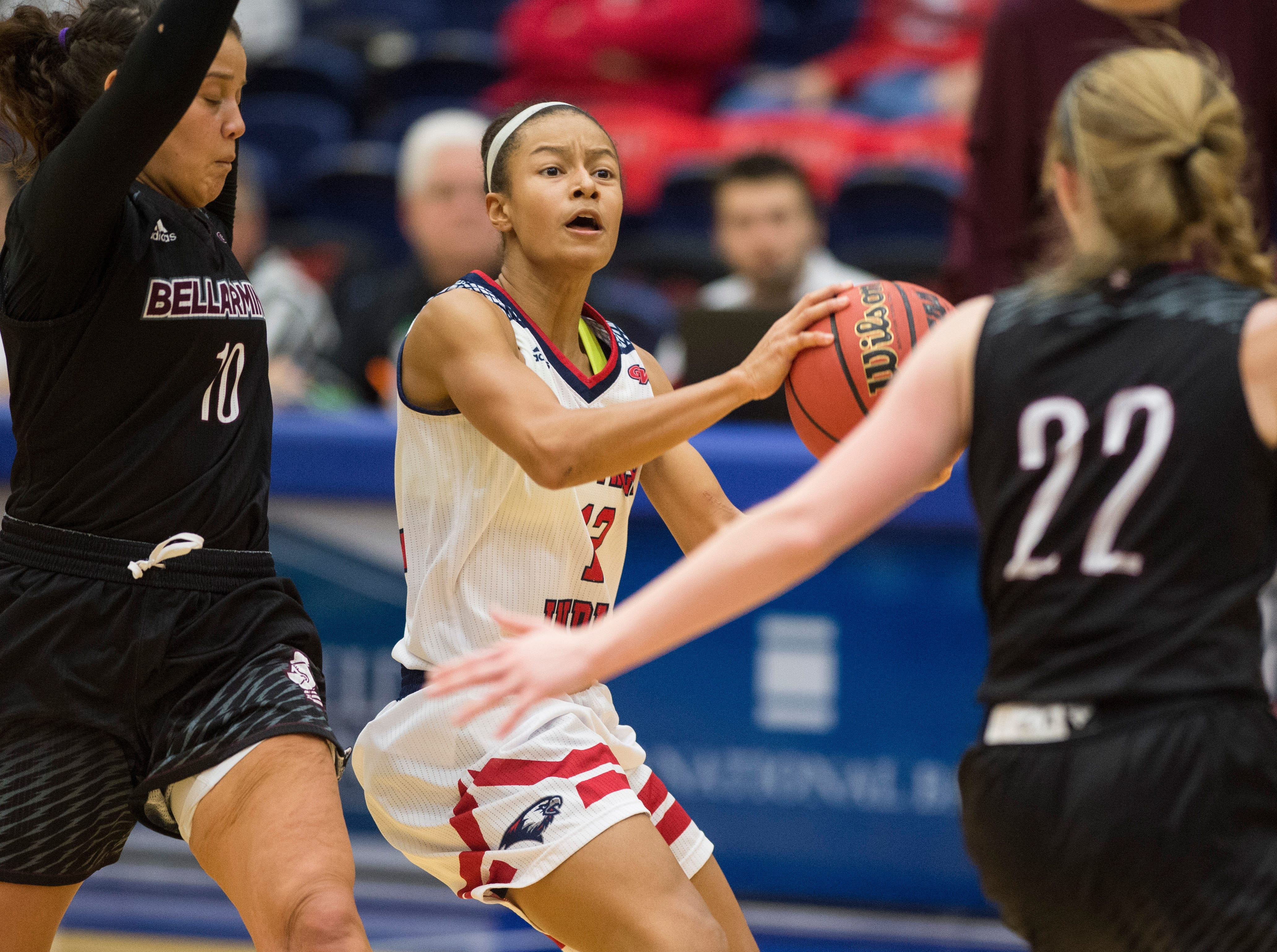 USI's Imani Guy (10) eyes the court for a pass during the USI vs Bellarmine game at the PAC Saturday, Dec. 1, 2018.