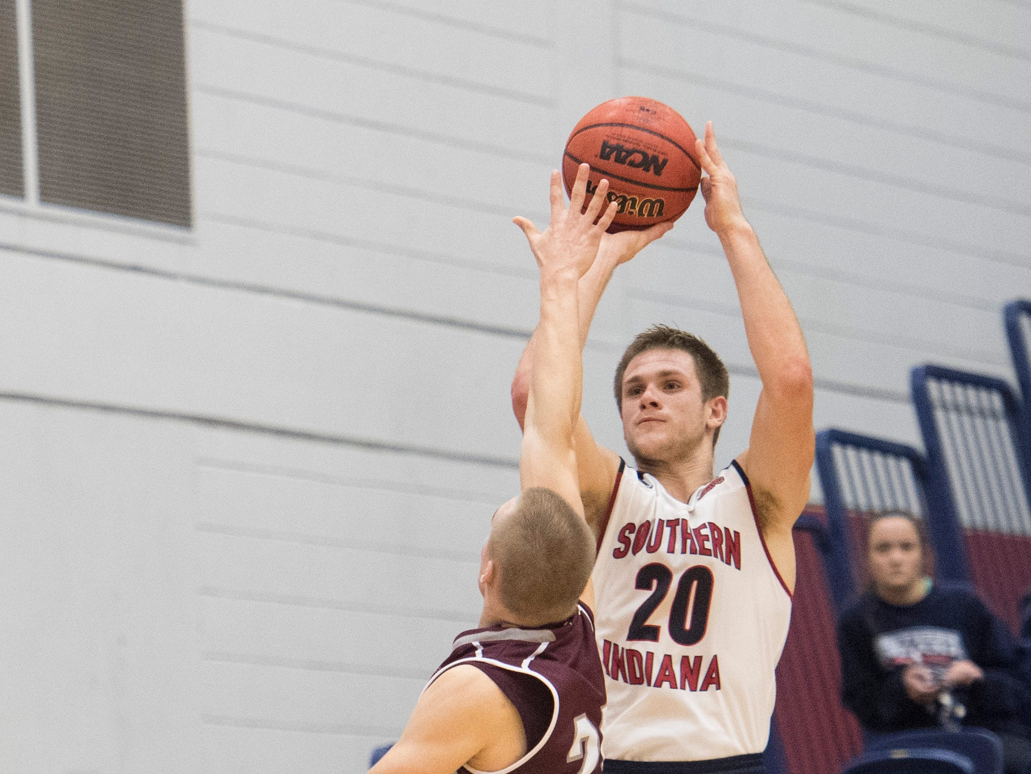 USI's Alex Stein (20) launches a 3-pointer during the USI vs Bellarmine game at the PAC Saturday, Dec. 1, 2018. USI lost 92-80.