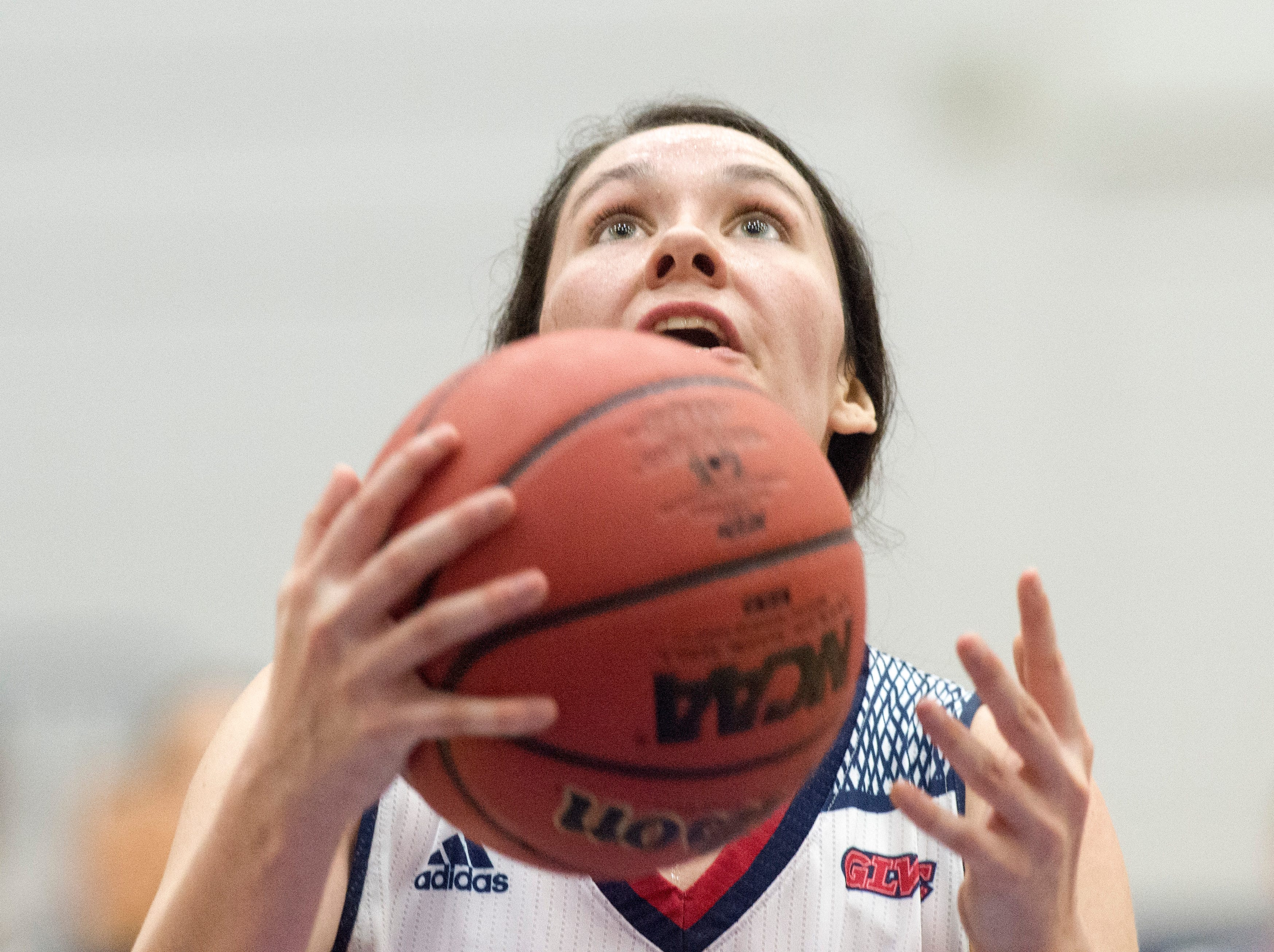 USI's Alex Davidson (21) looks up at the basket as she takes a shot during the USI vs Bellarmine game at the PAC Saturday, Dec. 1, 2018.