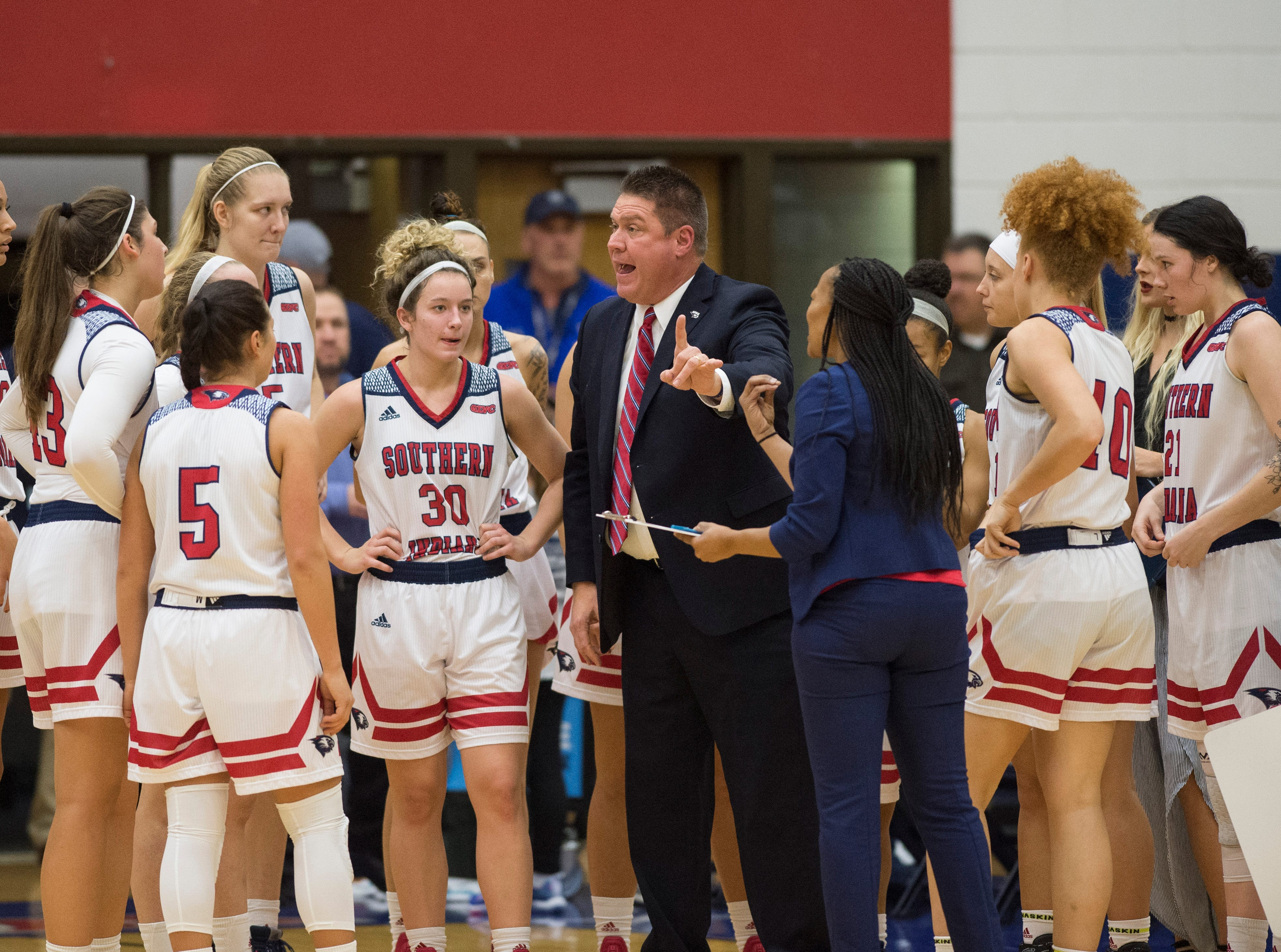 USI Women's Basketball Head Coach Rick Stein directs a play during a timeout in the USI vs Bellarmine game at the PAC Saturday, Dec. 1, 2018.