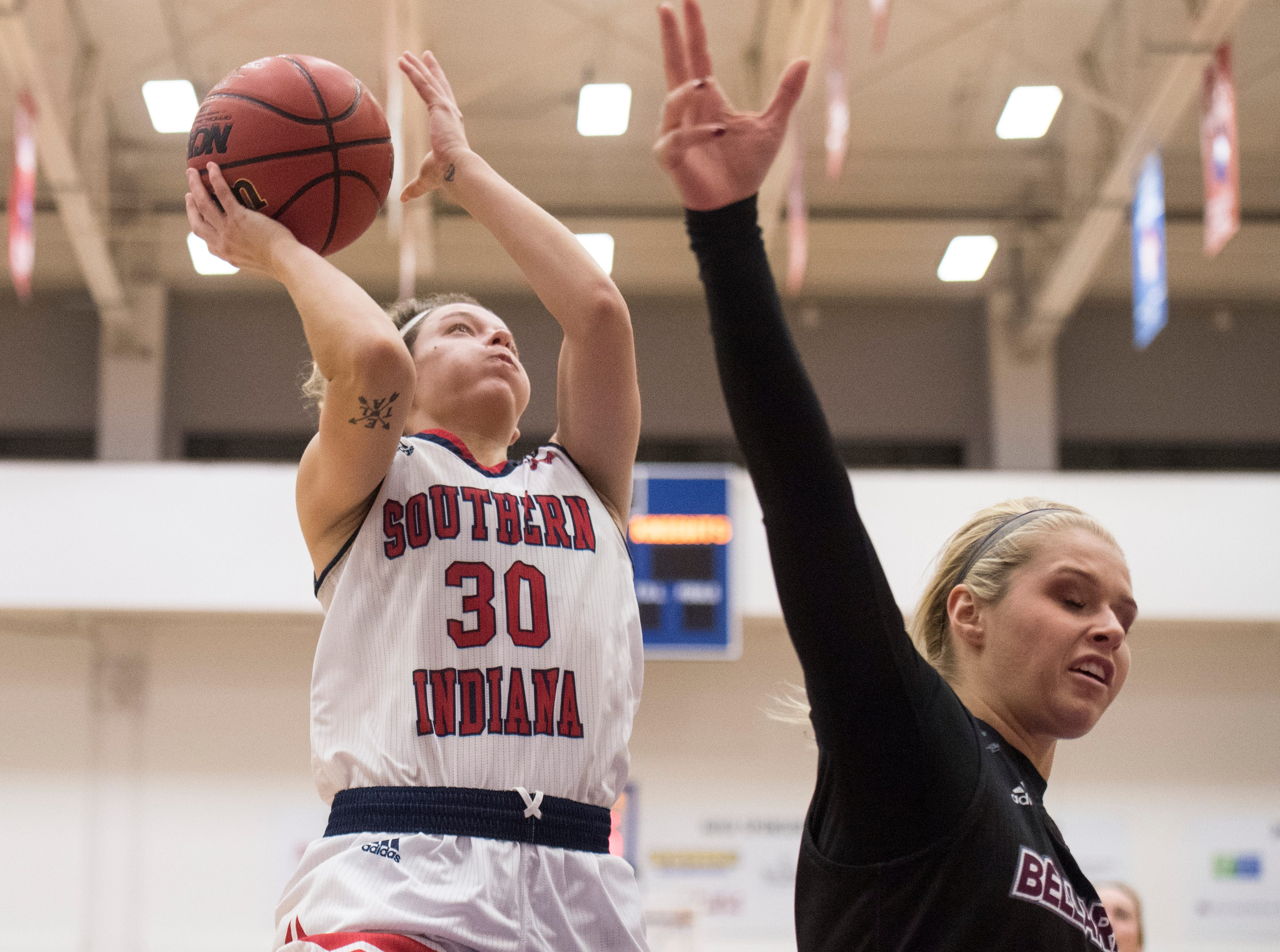 USI's Emma DeHart (30) leaps towards the basket during the USI vs Bellarmine game at the PAC Saturday, Dec. 1, 2018.