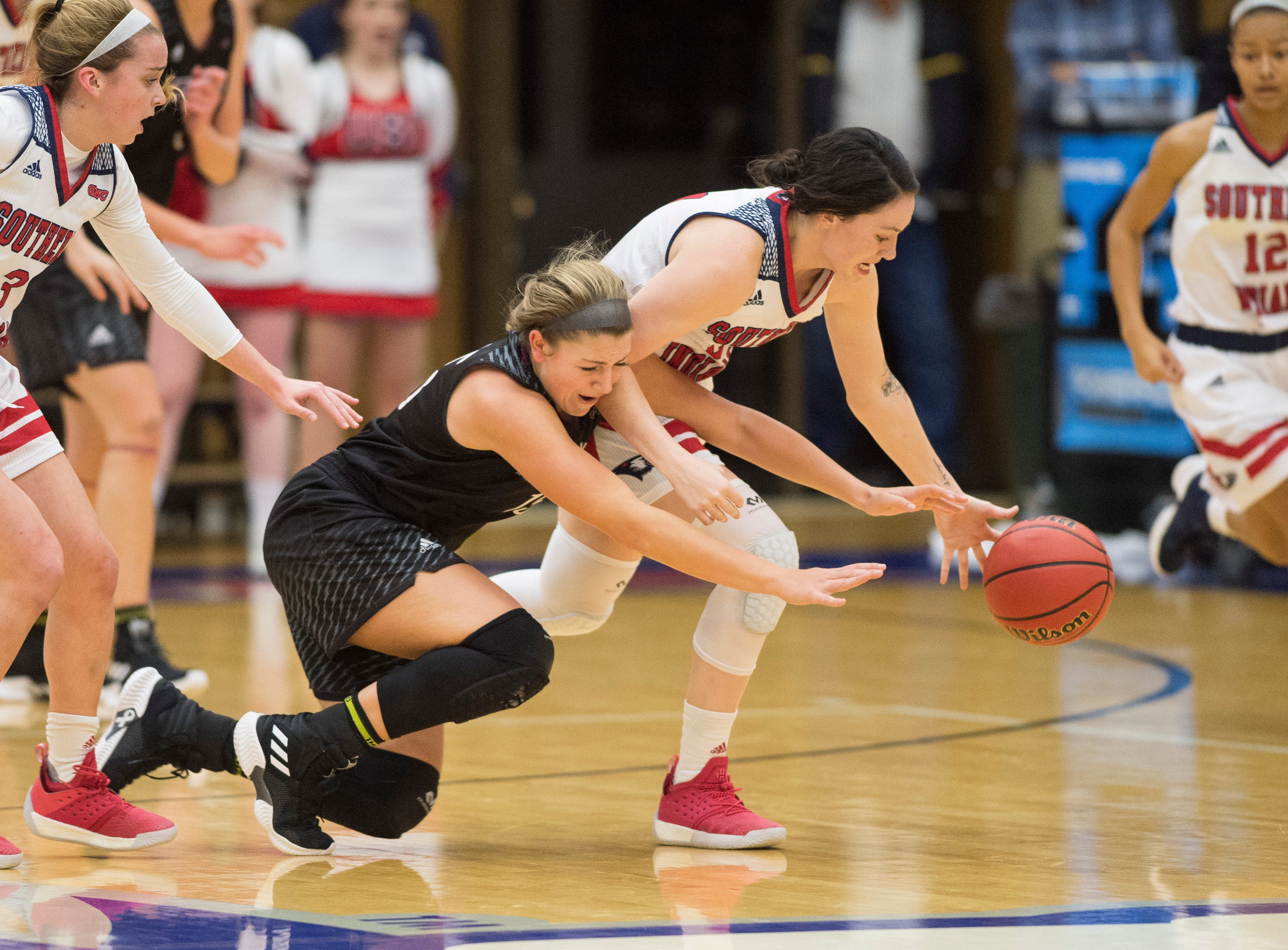 USI's Alex Davidson (21) reaches for a loose ball during the USI vs Bellarmine game at the PAC Saturday, Dec. 1, 2018.