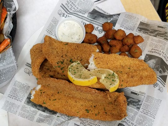 Catfish Willy's namesake--crunchy cornmeal-coated catfish fillets with a side of southern fried okra.