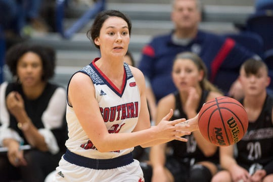 USI's Alex Davidson (21) passes the ball during the USI vs Bellarmine game at the PAC Saturday, Dec. 1, 2018.