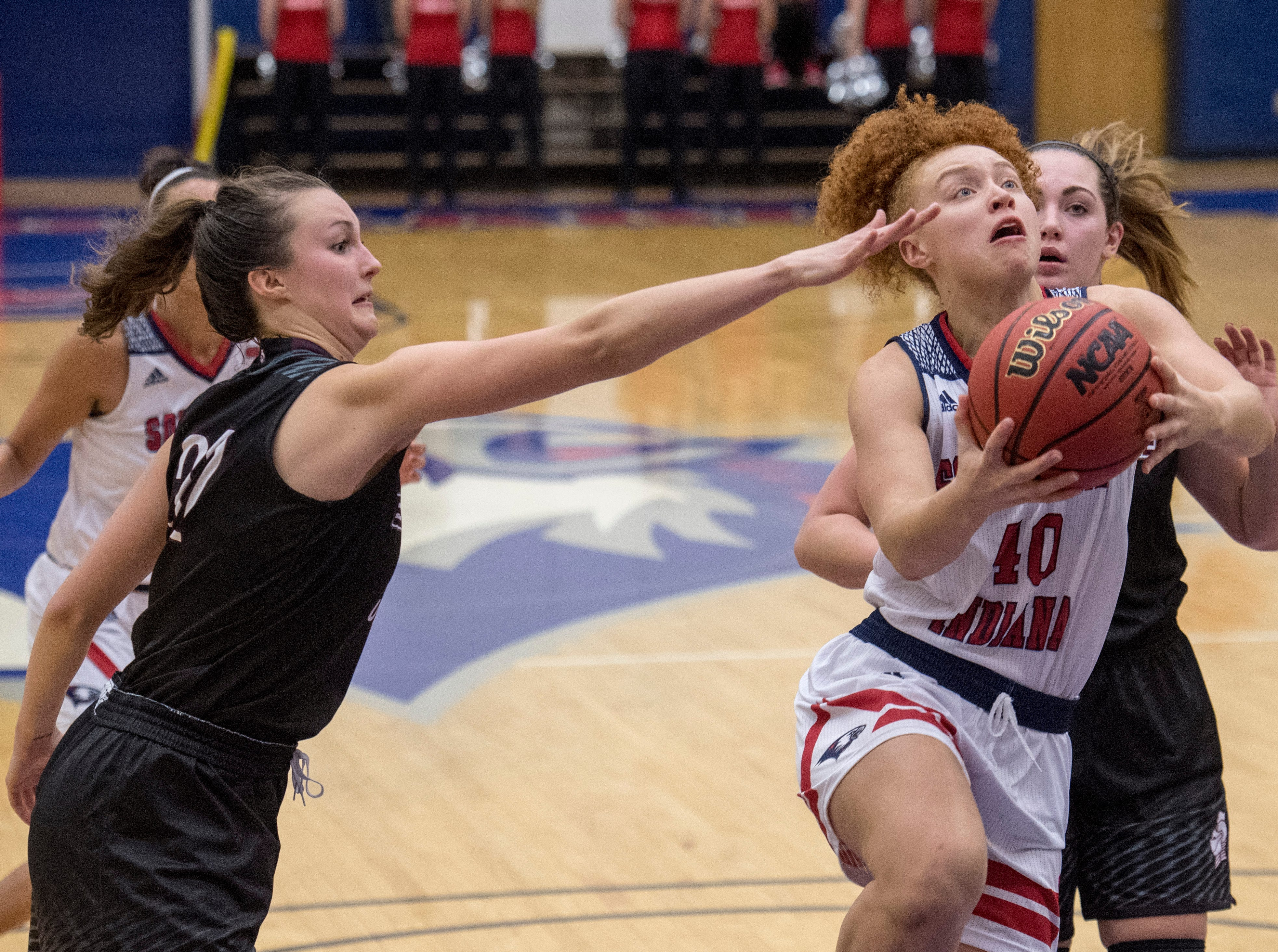 USI's Mikayla Rowan (40) goes for 2-points during the USI vs Bellarmine game at the PAC Saturday, Dec. 1, 2018.