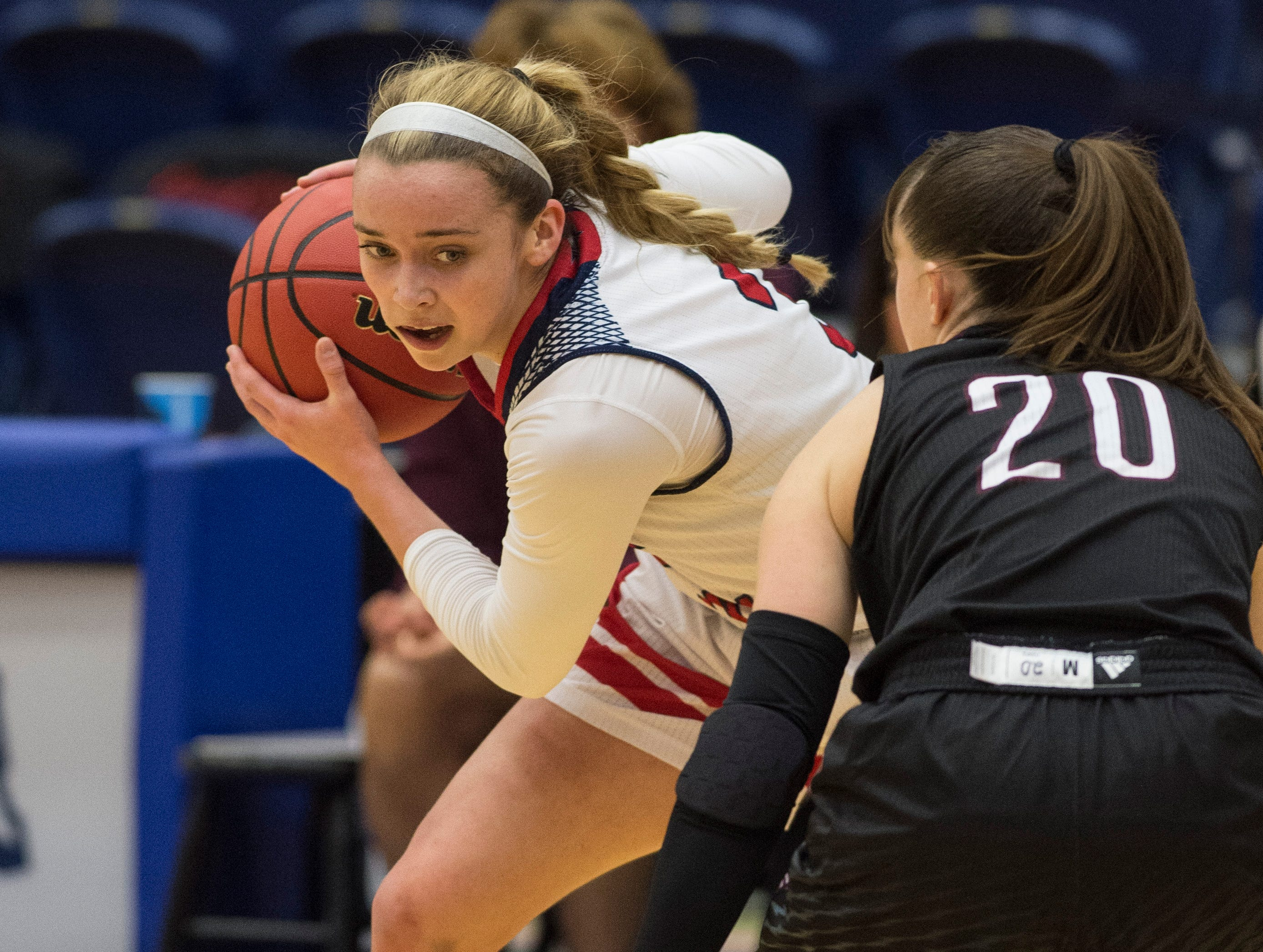 USI's Kennedy Williams (3) is guarded by Bellarmine's Katie Downey (20) during the USI vs Bellarmine game at the PAC Saturday, Dec. 1, 2018.