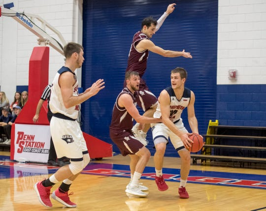 USI's Alex Stein (20) is surrounded by Bellarmine defense during the USI vs Bellarmine basketball game at the PAC Saturday, Dec. 1, 2018.