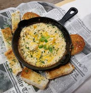 Hot blue crab and shrimp dip at Catfish Willy's served with toasted New Orleans bread.