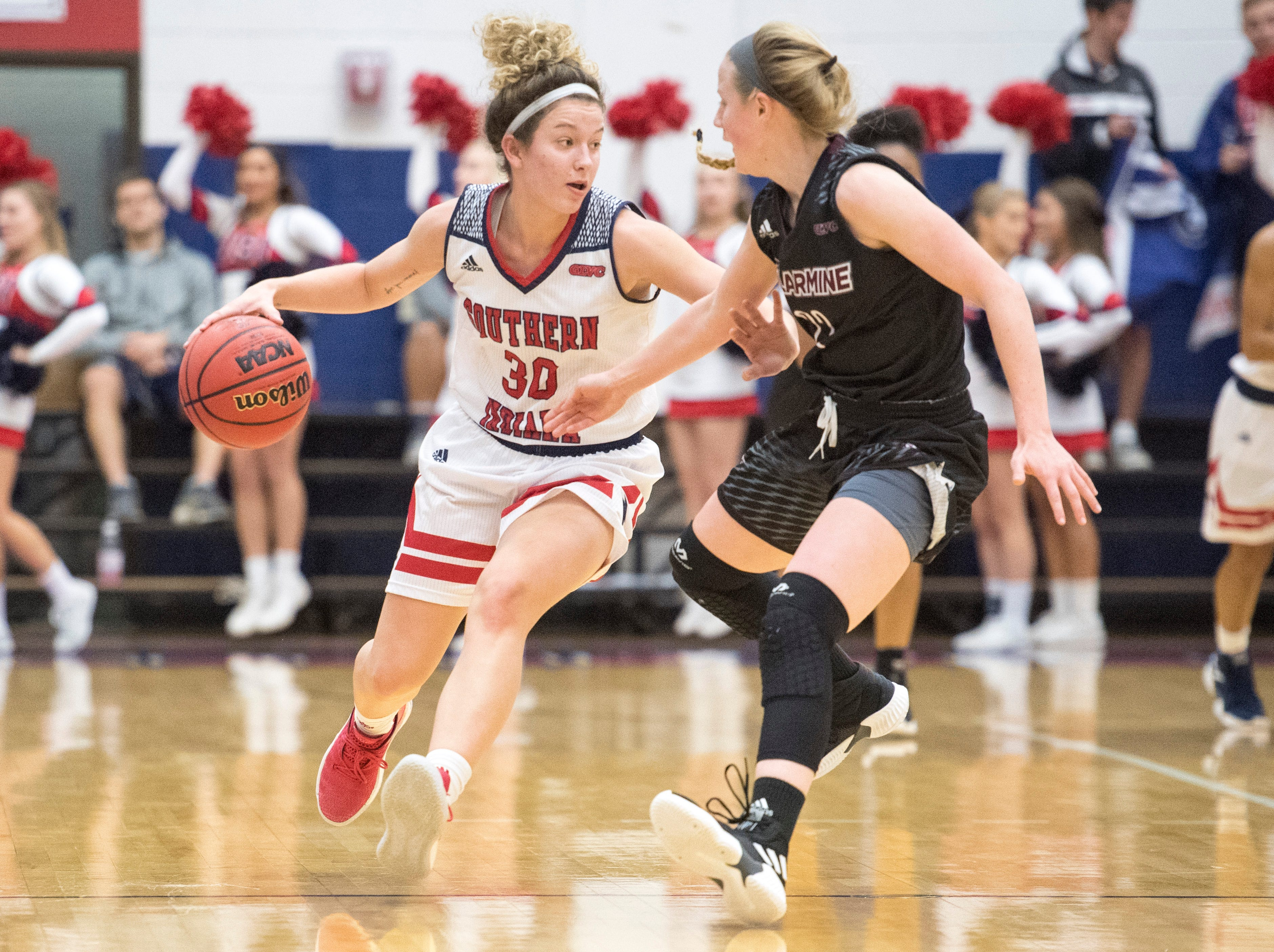 USI's Emma DeHart (30) dribbles the ball during the USI vs Bellarmine game at the PAC Saturday, Dec. 1, 2018.