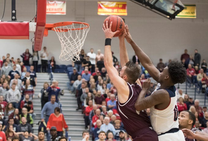 USI's Kobe Caldwell (0) fouls Bellarmine's Parker Chitty (31) in the final minute of the during the USI vs Bellarmine game at the PAC Saturday, Dec. 1, 2018. USI lost 92-80.