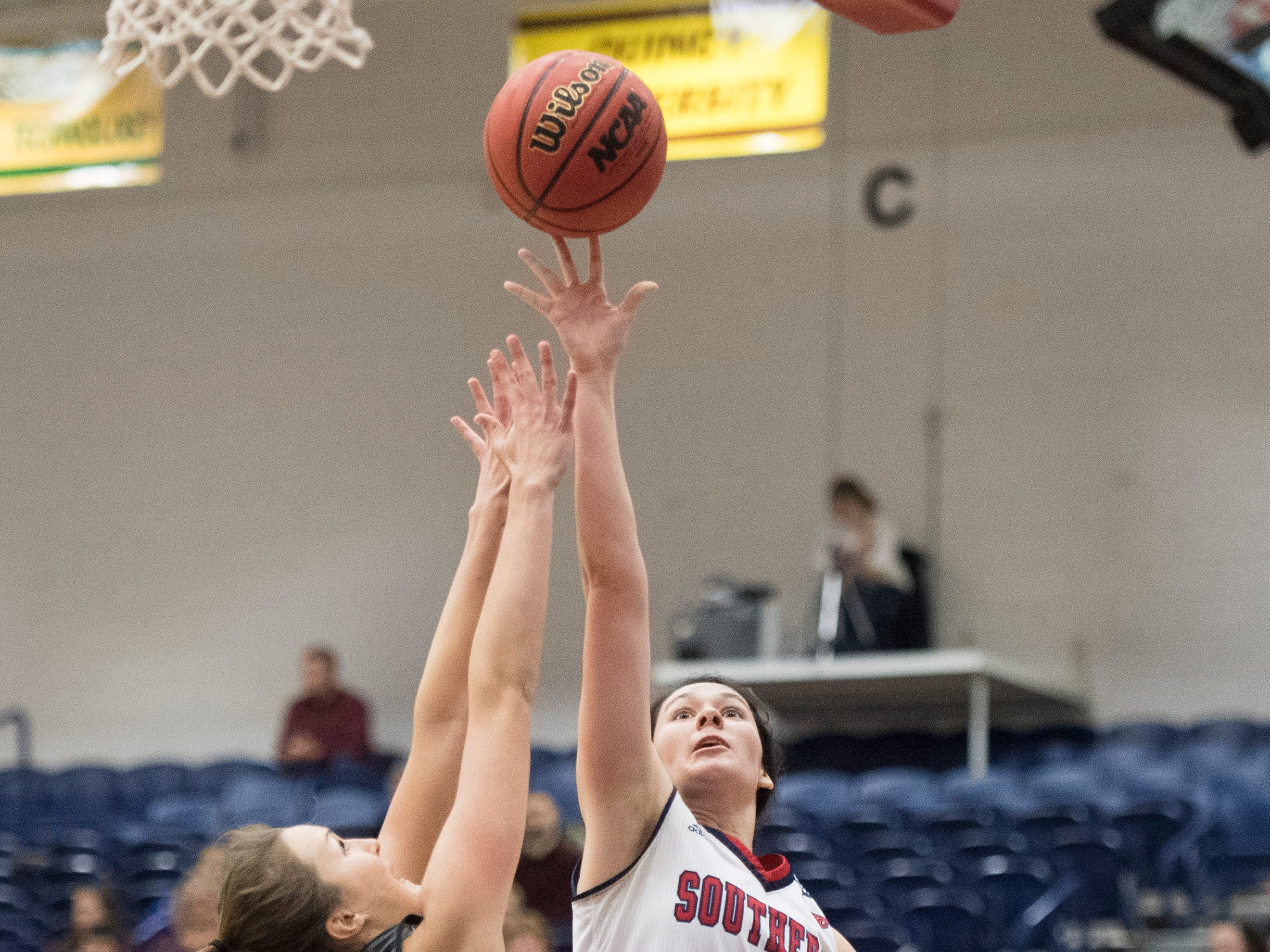 USI's Alex Davidson (21) reaches for the basket during the USI vs Bellarmine game at the PAC Saturday, Dec. 1, 2018.