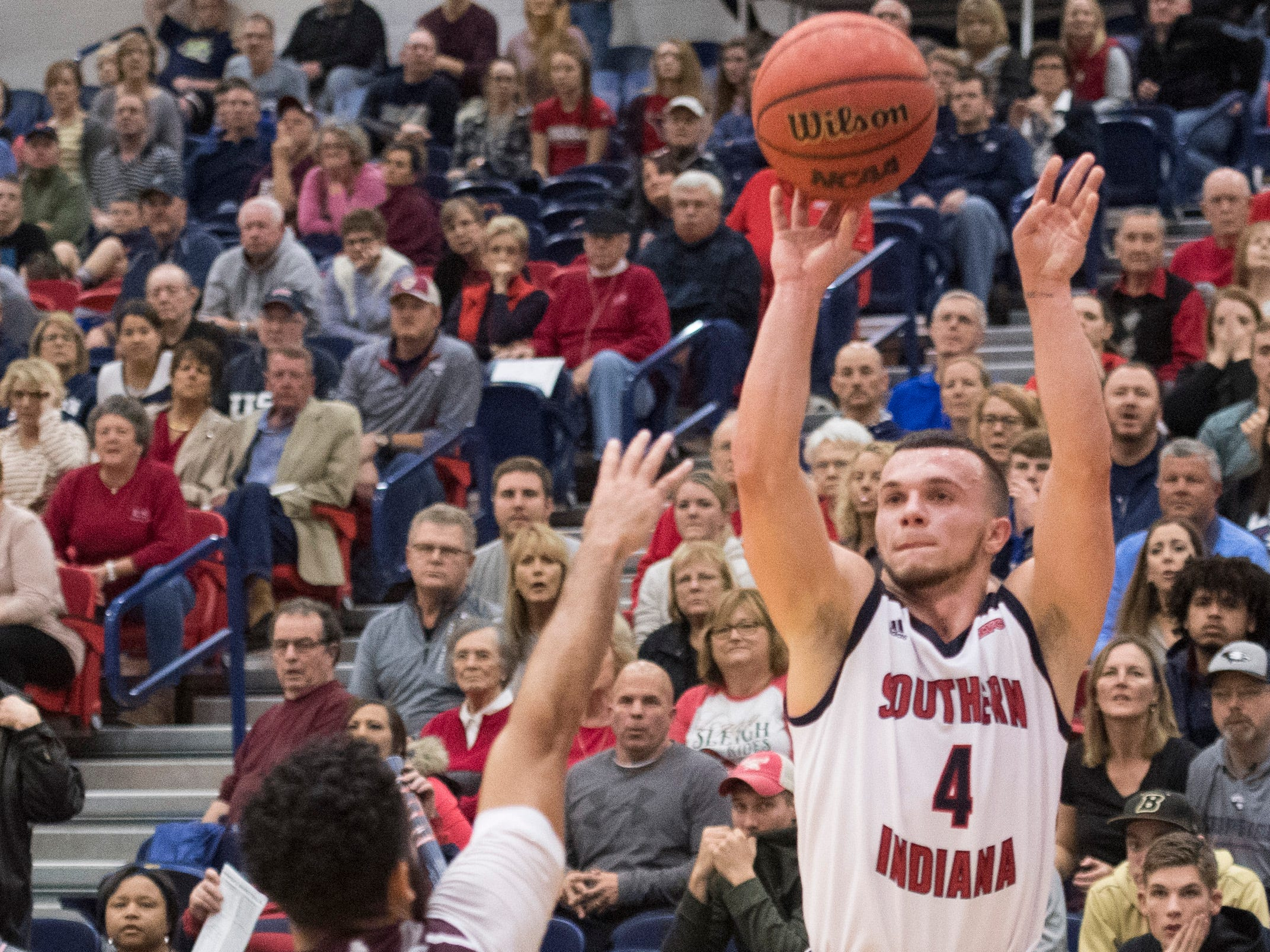 USI's Braden Fitzjerrells (4) launches a 3-pointer during the USI vs Bellarmine game at the PAC Saturday, Dec. 1, 2018.