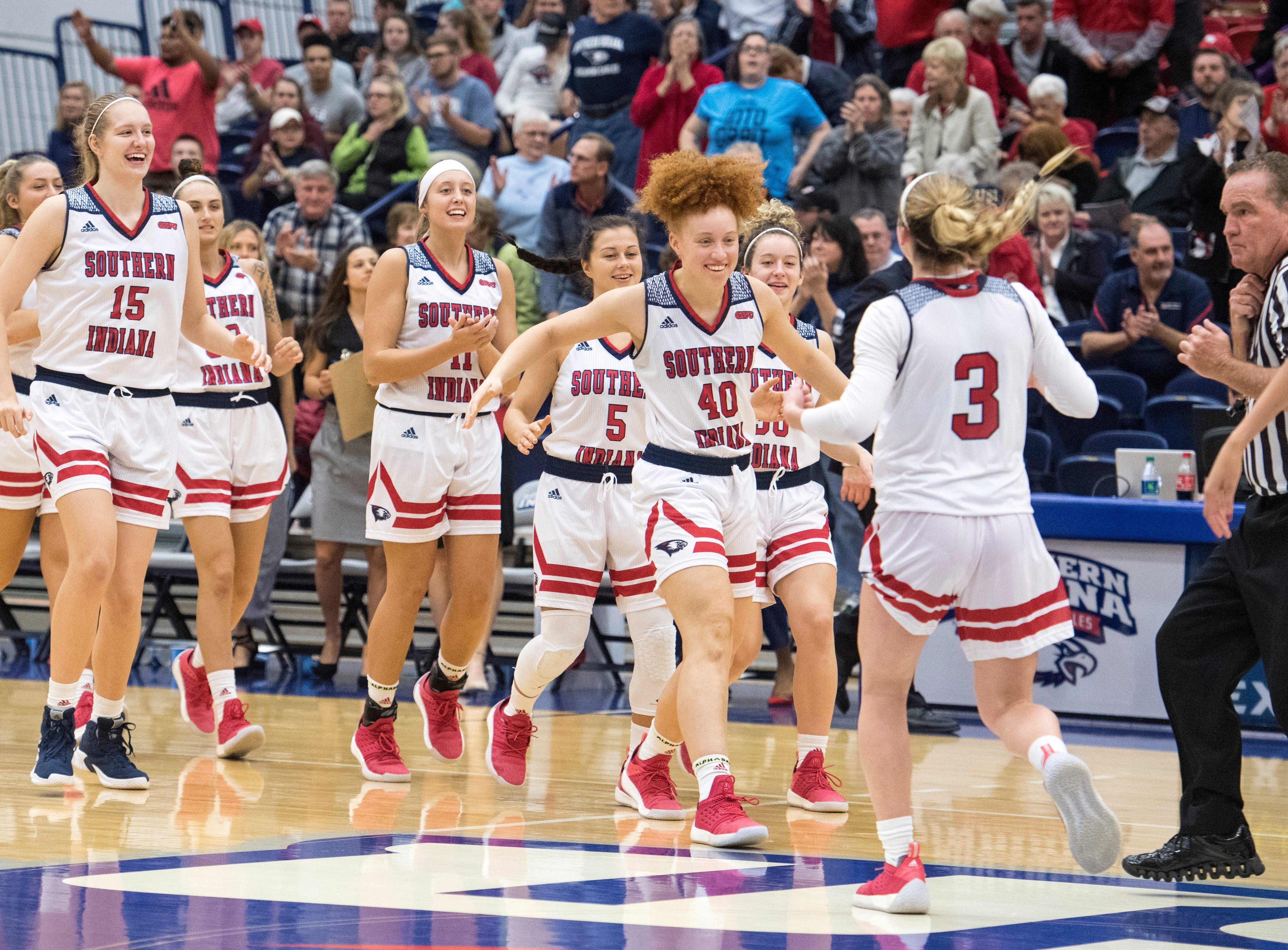The USI Screaming Eagles Women's Basketball team celebrate after their 73-67 victory over the Bellarmine Knights Saturday, Dec. 1, 2018.