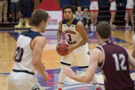 USI's Mateo Rivera (3) looks to pass the ball in the first half of the USI vs Bellarmine basketball game at the PAC Saturday, Dec. 1, 2018.