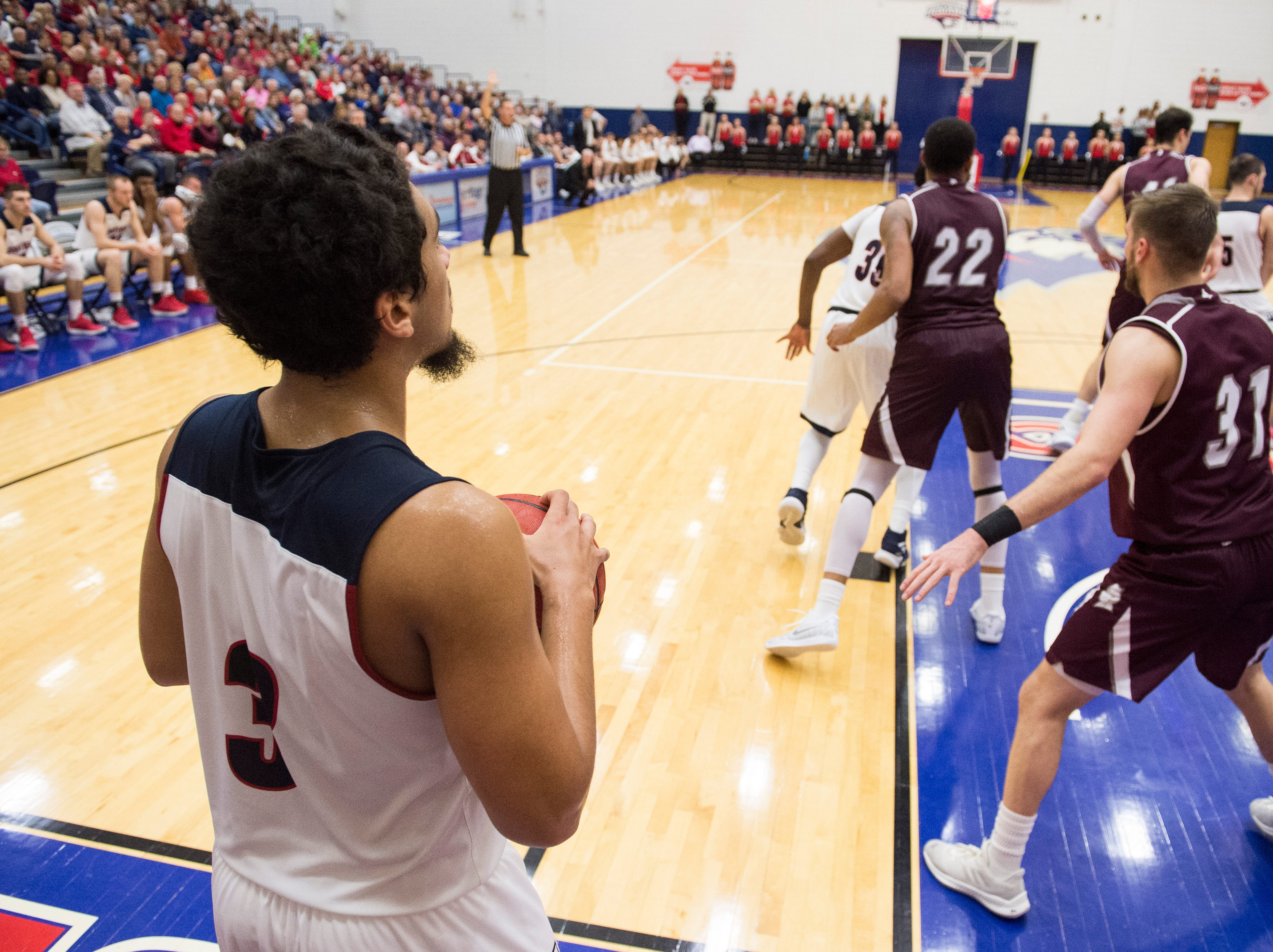 USI's Mateo Rivera (3) looks for an open teammate to pass the ball during the USI vs Bellarmine game at the PAC Saturday, Dec. 1, 2018.