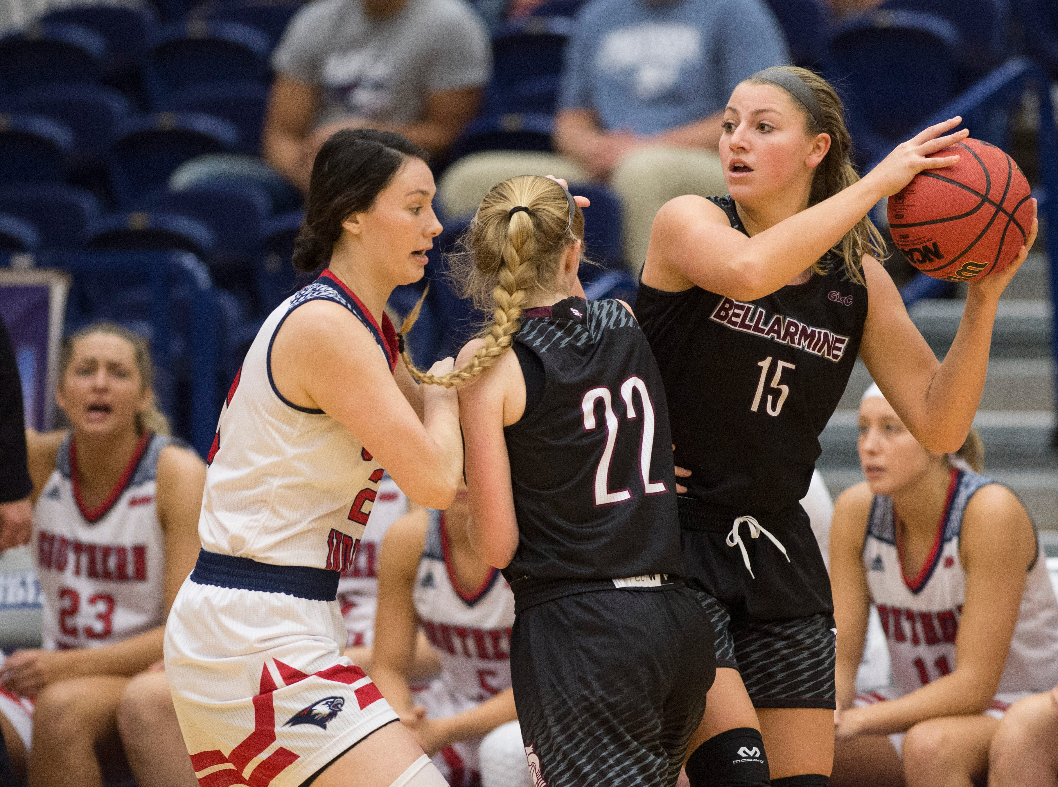 Bellarmine's Mallory Schwartz (15) looks to pass the ball during the USI vs Bellarmine game at the PAC Saturday, Dec. 1, 2018.