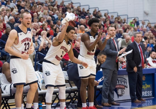 The USI bench cheers on their teammates during the USI vs Bellarmine game at the PAC Saturday, Dec. 1, 2018.