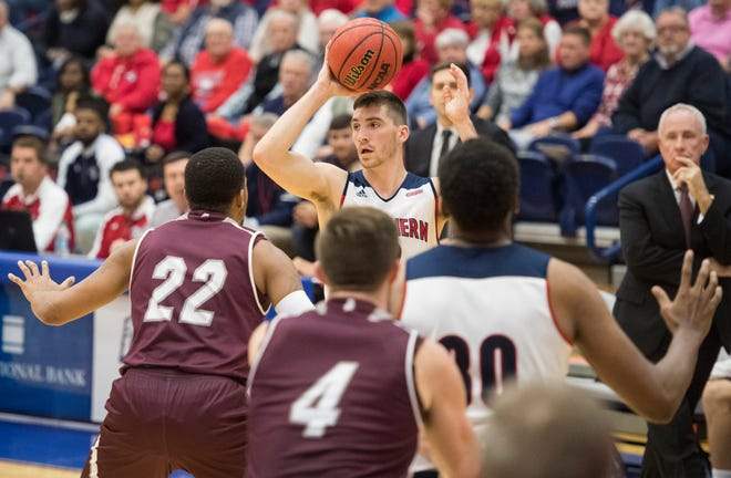 USI's Jacob Norman (2) looks to pass the ball during the USI vs Bellarmine game at the PAC Saturday, Dec. 1, 2018.