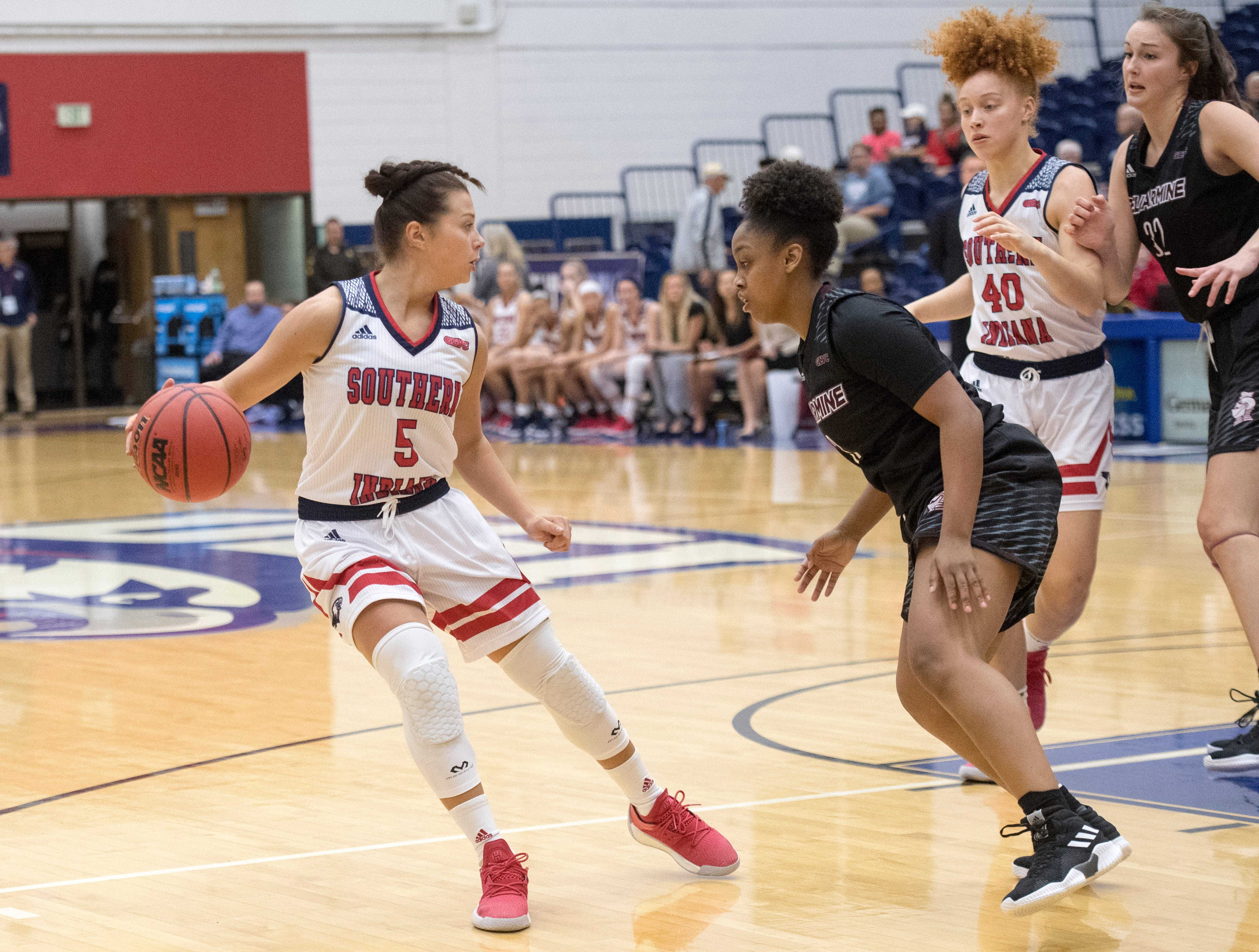 USI's Milana Matias (5) is guarded by Bellarmine's Breia Torrens (3) during the USI vs Bellarmine game at the PAC Saturday, Dec. 1, 2018.