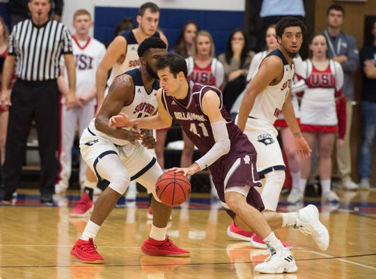 Bellarmine's Adam Eberhard (41) dribbles around USI defense during the USI vs Bellarmine game at the PAC Saturday, Dec. 1, 2018.