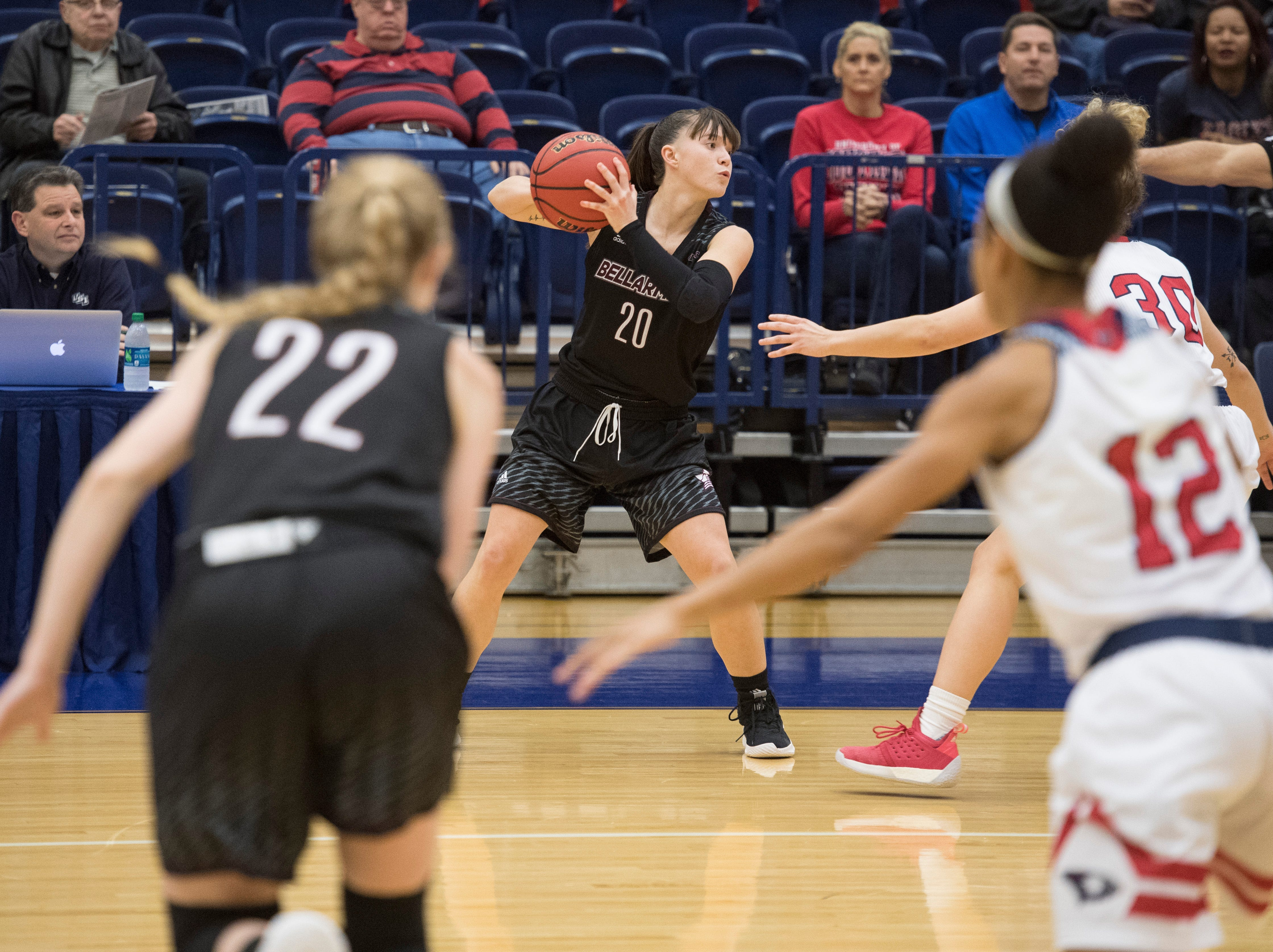 Bellarmine's Katie Downey (20) looks to pass the ball during the USI vs Bellarmine game at the PAC Saturday, Dec. 1, 2018.