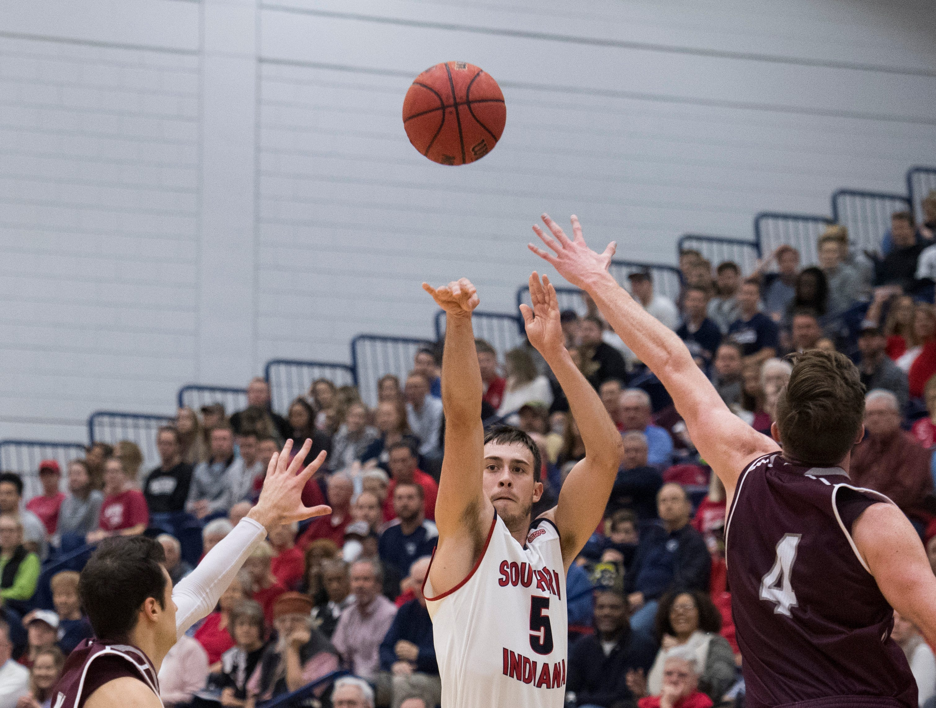 USI's Nate Hansen (5) takes a 3-point shot during the first half of the USI vs Bellarmine basketball game at the PAC Saturday, Dec. 1, 2018.