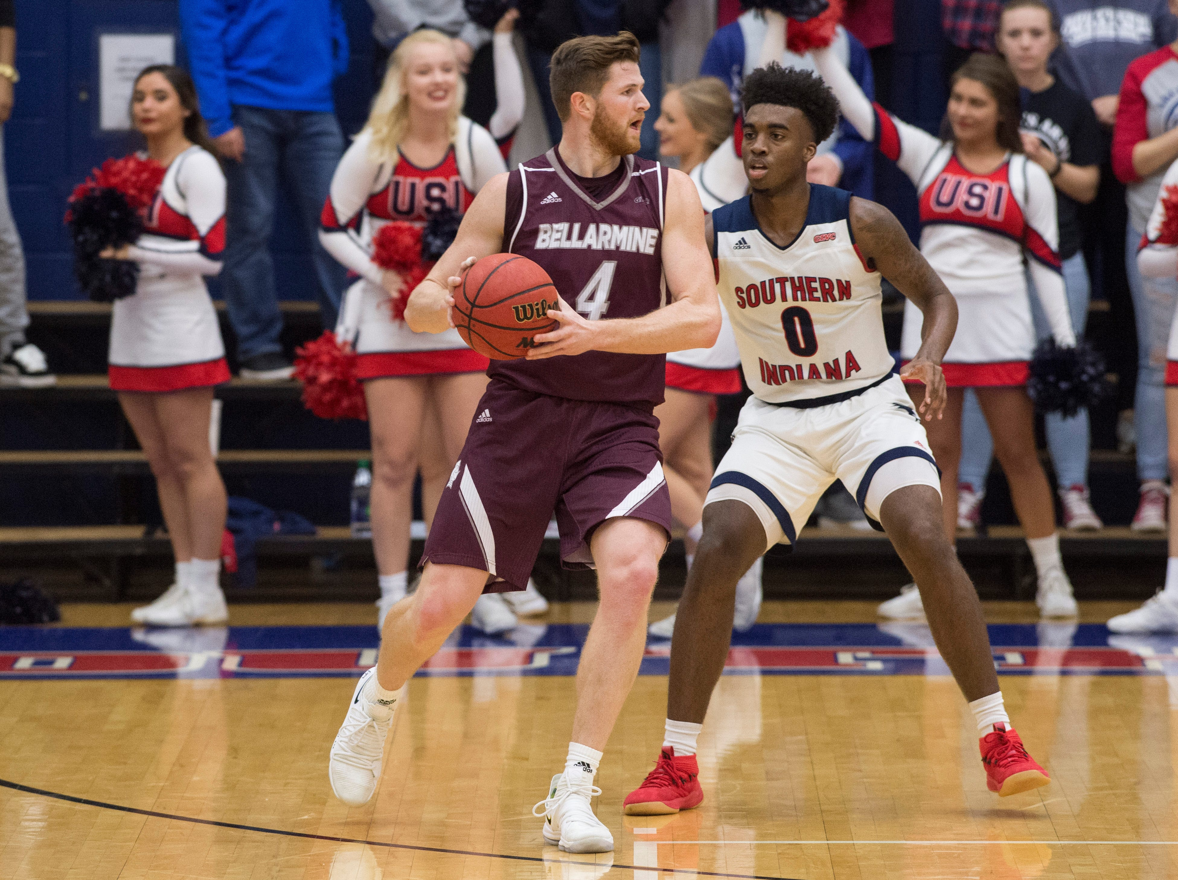 Bellarmine's Ben Weyer (4) looks for an open man during the USI vs Bellarmine game at the PAC Saturday, Dec. 1, 2018.