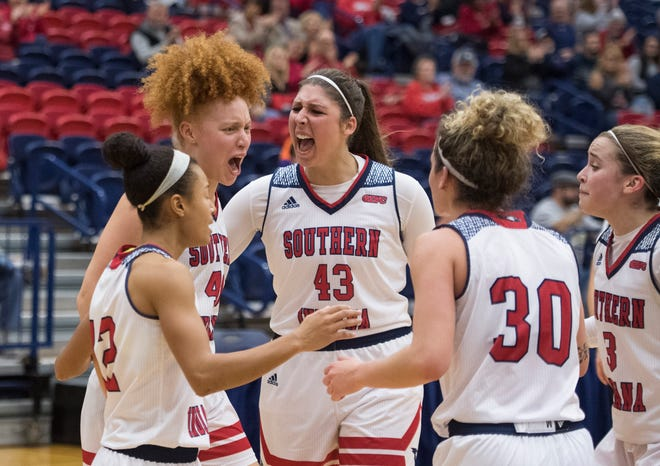 The USI Screaming Eagles women's basketball team celebrate after a 3-point basket during the USI vs Bellarmine game at the PAC Saturday, Dec. 1, 2018.