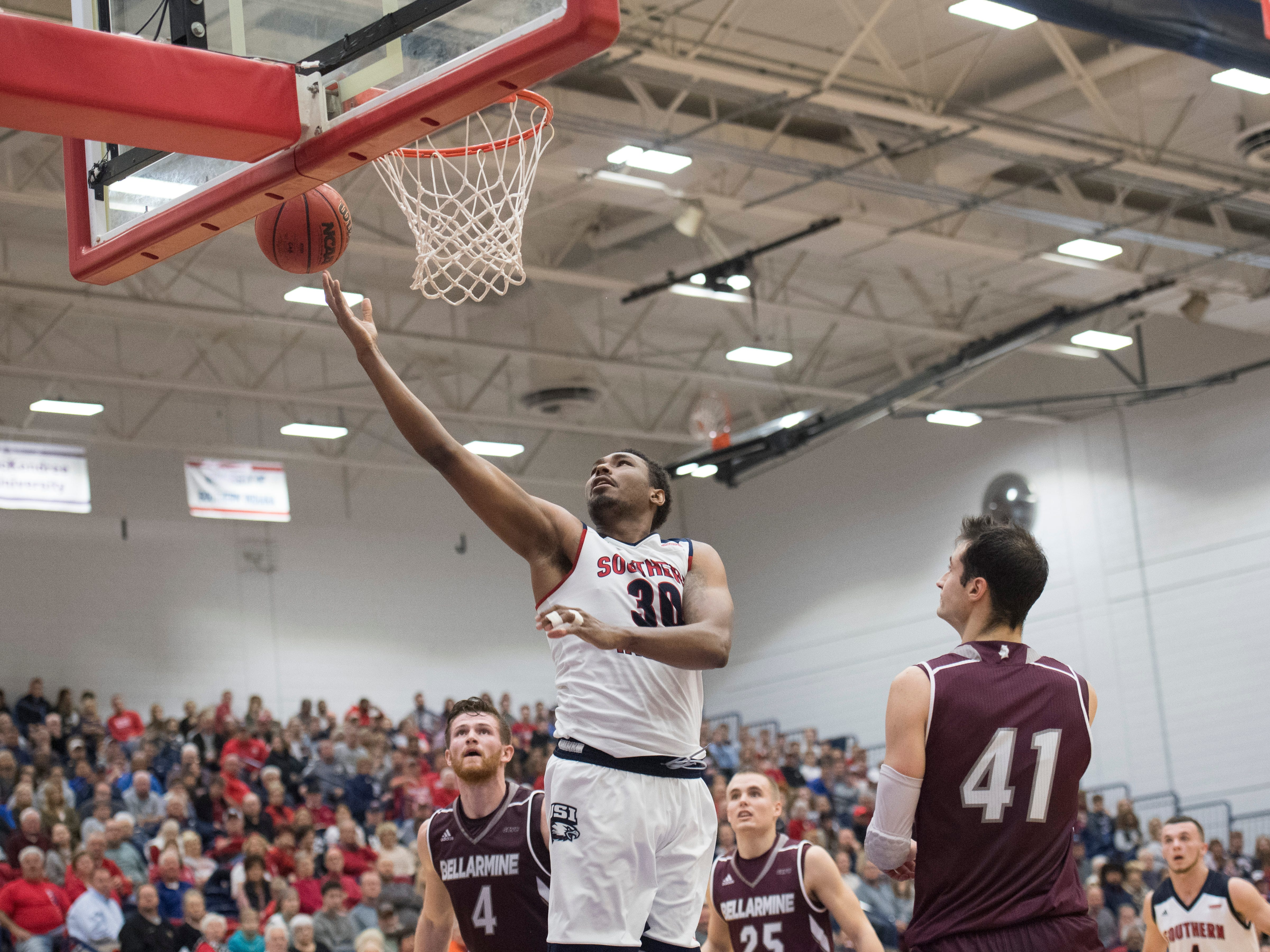 USI's Josh Price (30) reaches for the basket during the USI vs Bellarmine basketball game at the PAC Saturday, Dec. 1, 2018.