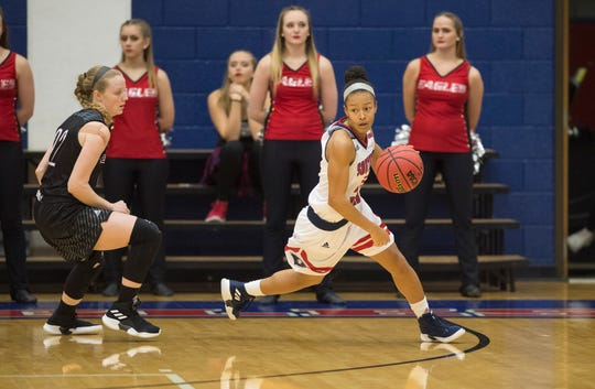 USI's Imani Guy (10) eyes her options during the USI vs Bellarmine game at the PAC Saturday, Dec. 1, 2018.
