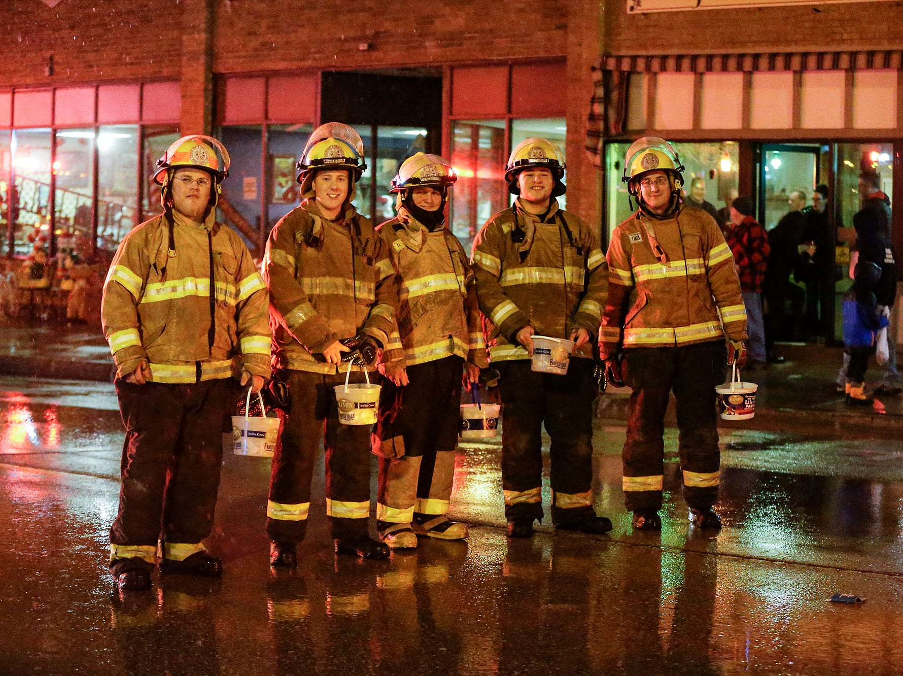 Members of the Town of Fond du Lac fire department pose during the downtown Fond du Lac Christmas parade Saturday, December 1, 2018. Doug Raflik/USA TODAY NETWORK-Wisconsin