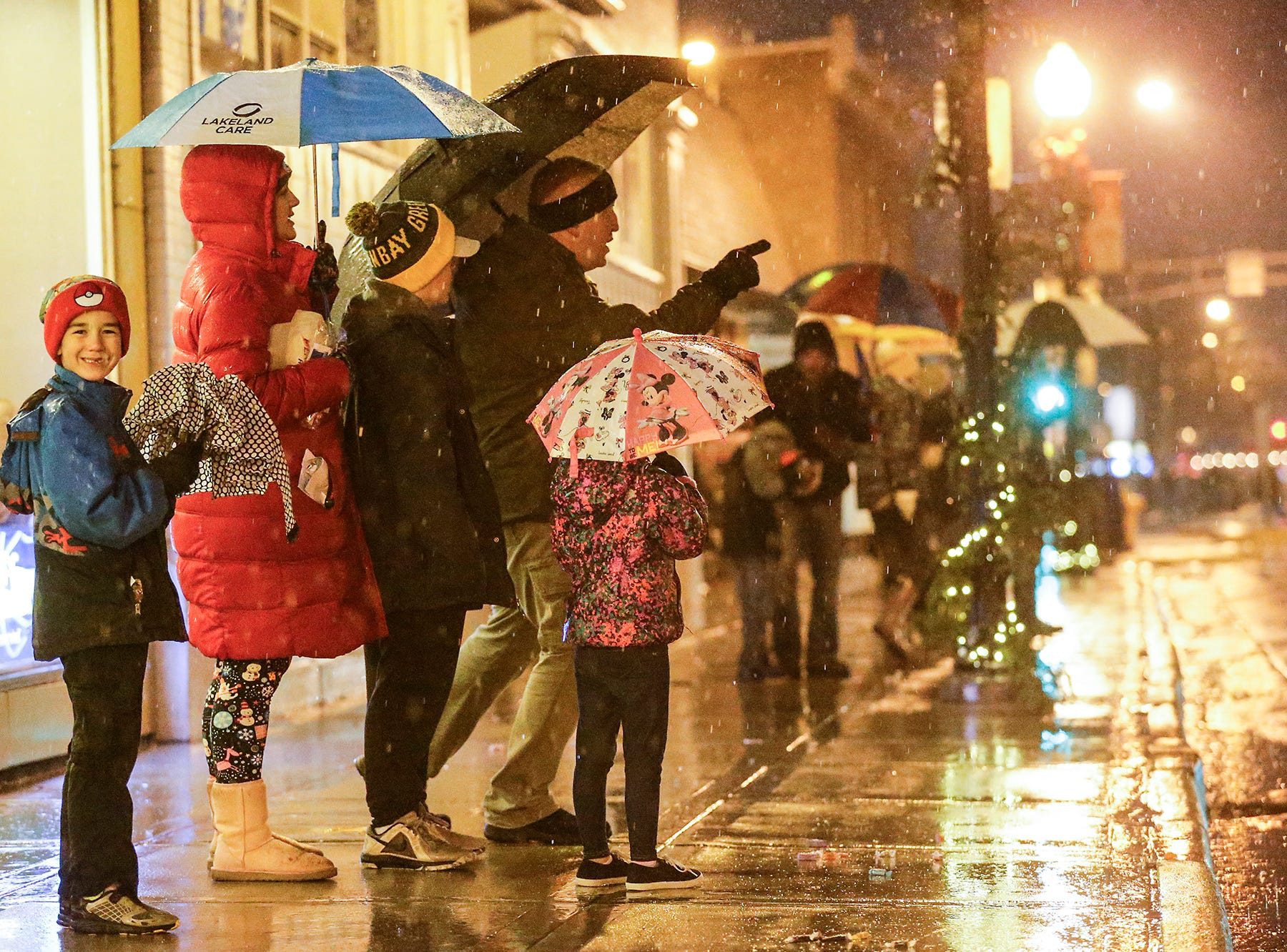 A few people braved the pouring rain to watch the downtown Fond du Lac Christmas parade Saturday, December 1, 2018. Doug Raflik/USA TODAY NETWORK-Wisconsin