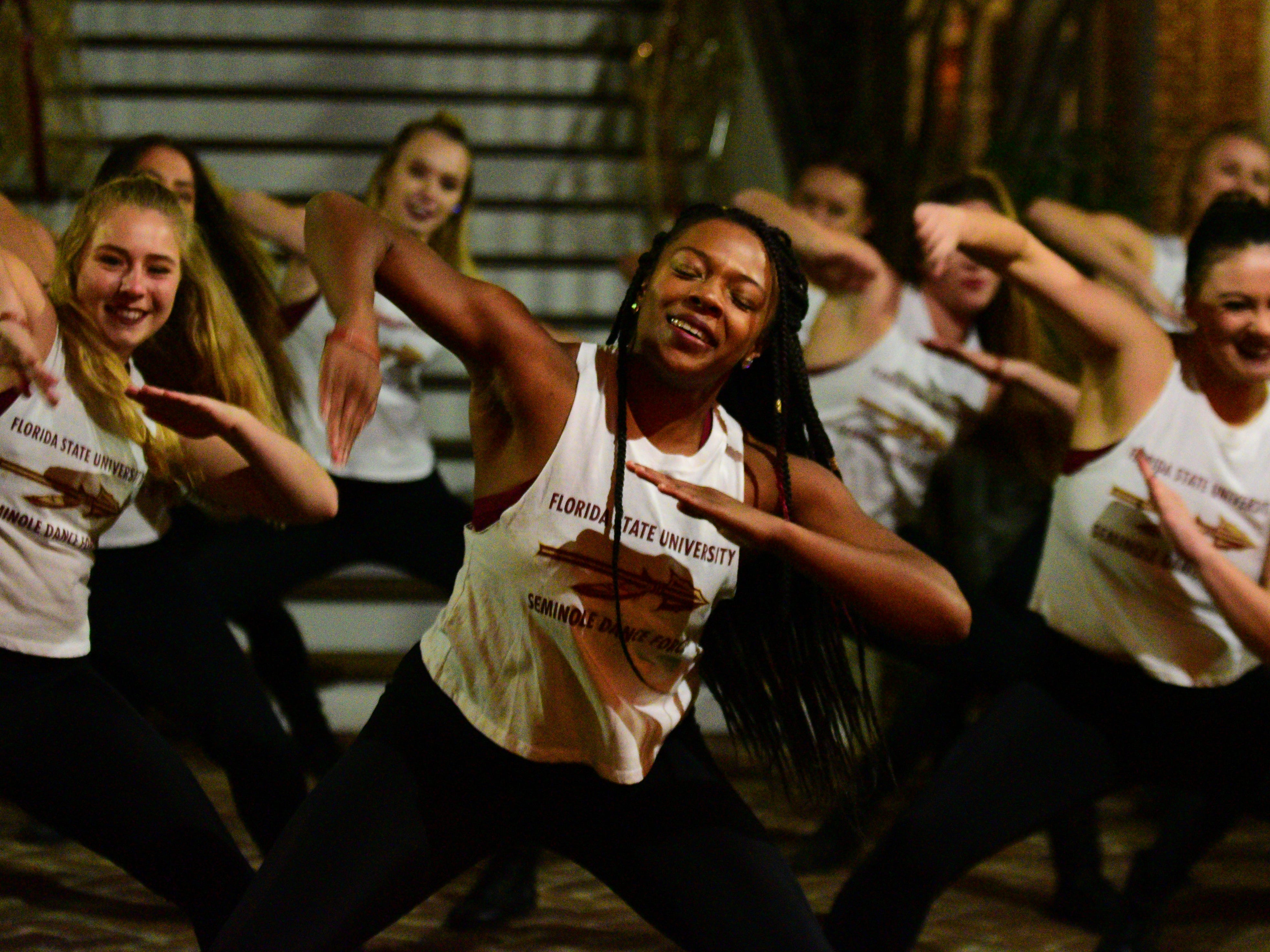Seminole Dance Force performs at a fundraiser for the Hot Yoga shooting victims at the President's House on Monday.