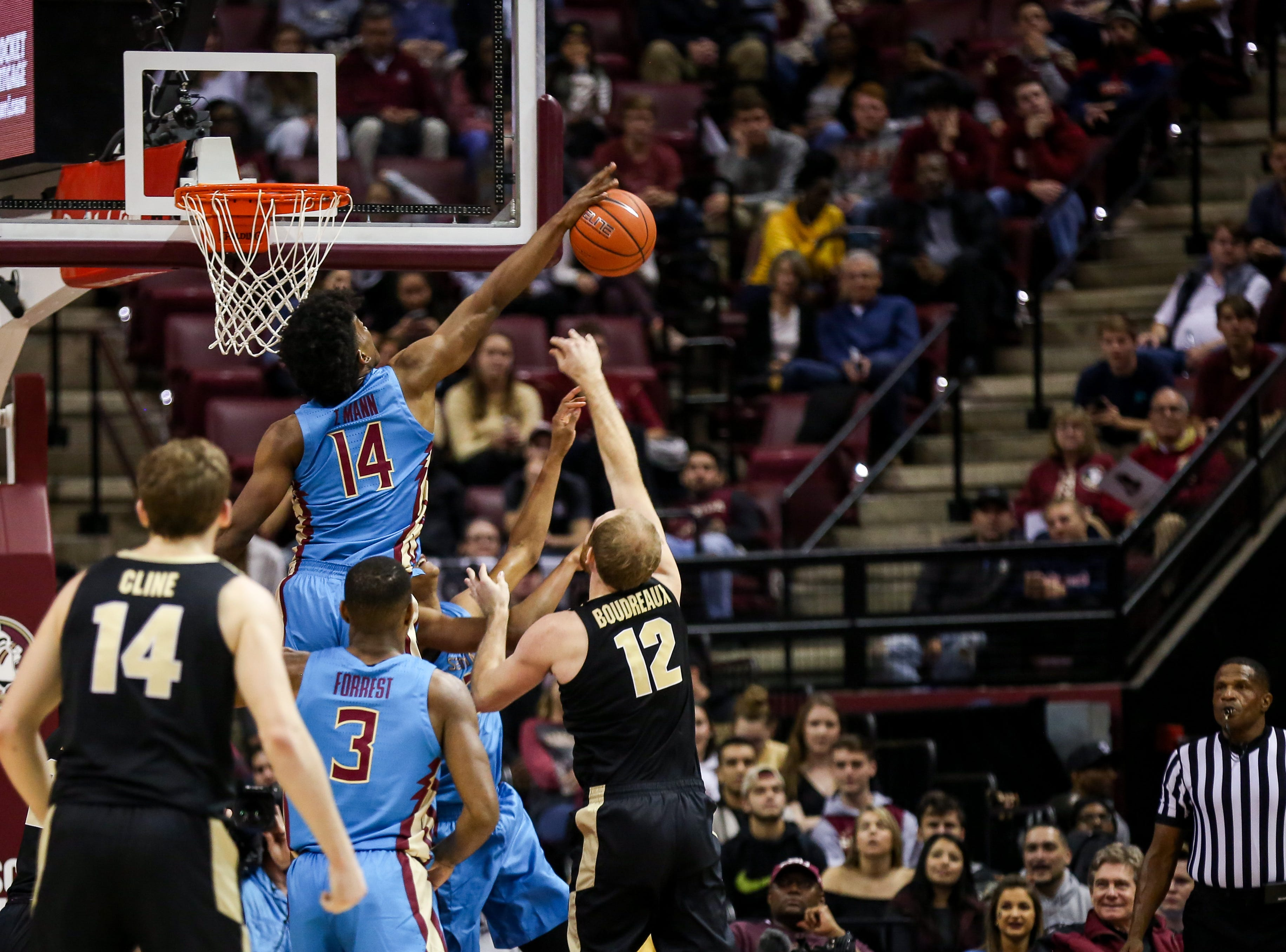 Terance Mann (14) denied a Purdue layup attempt in the first half on Wednesday, November 28th.