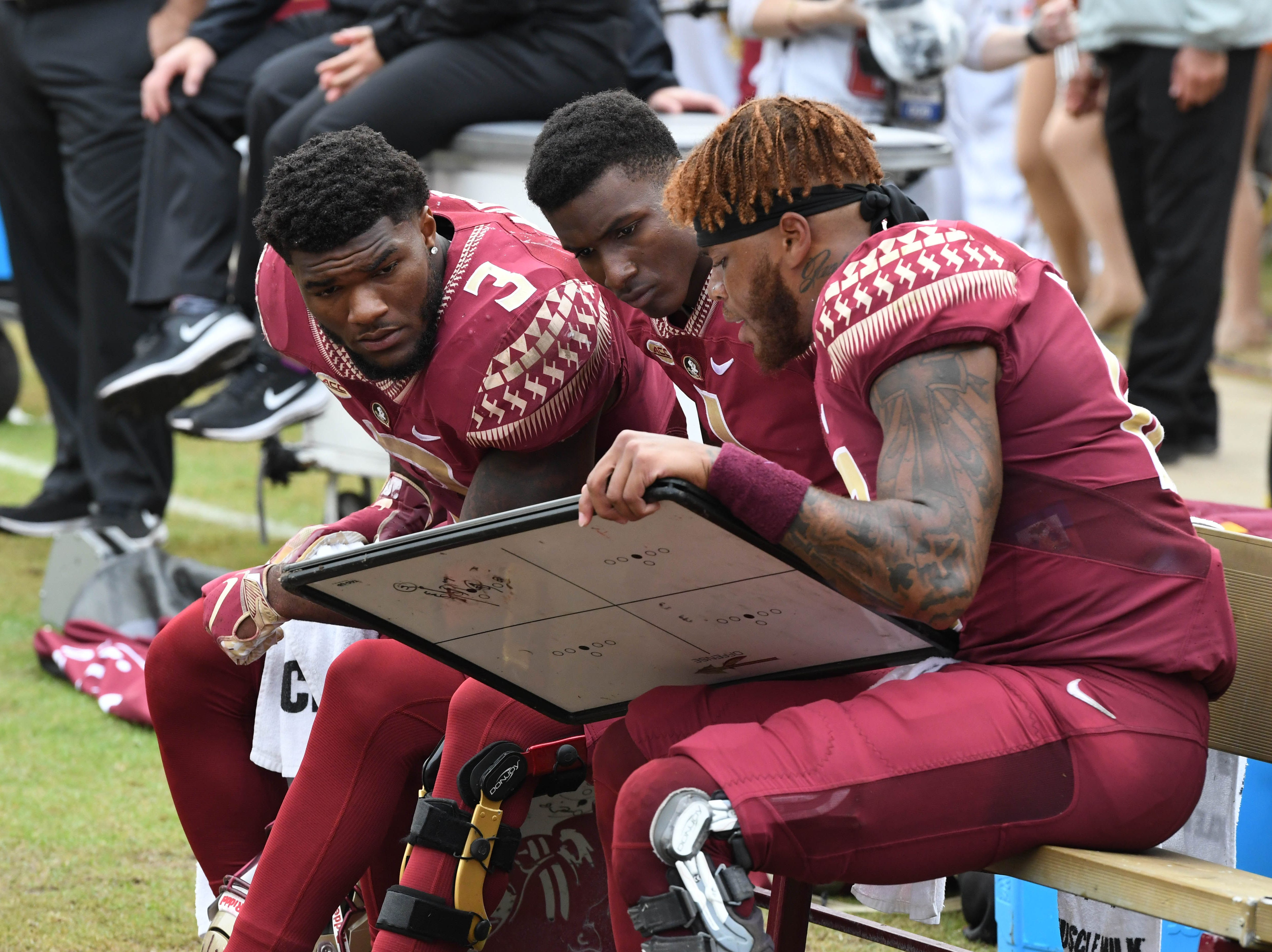FSU redshirt junior quarter back Deondre Francois (12) drawing out a play in the third quarter of the FSU game against UF at Doak Campbell Stadium on Novemeber 24, 2018.