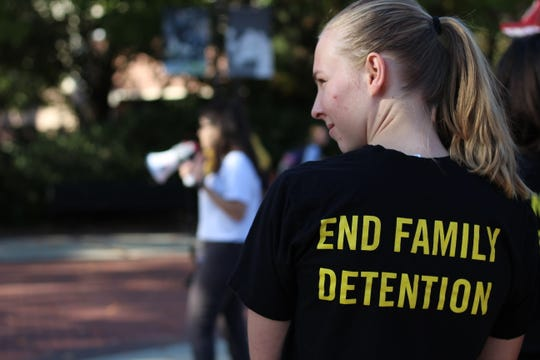Amnesty International's Public Relations Chair, Bridget Foster, protests the conditions faced by those seeking asylum.