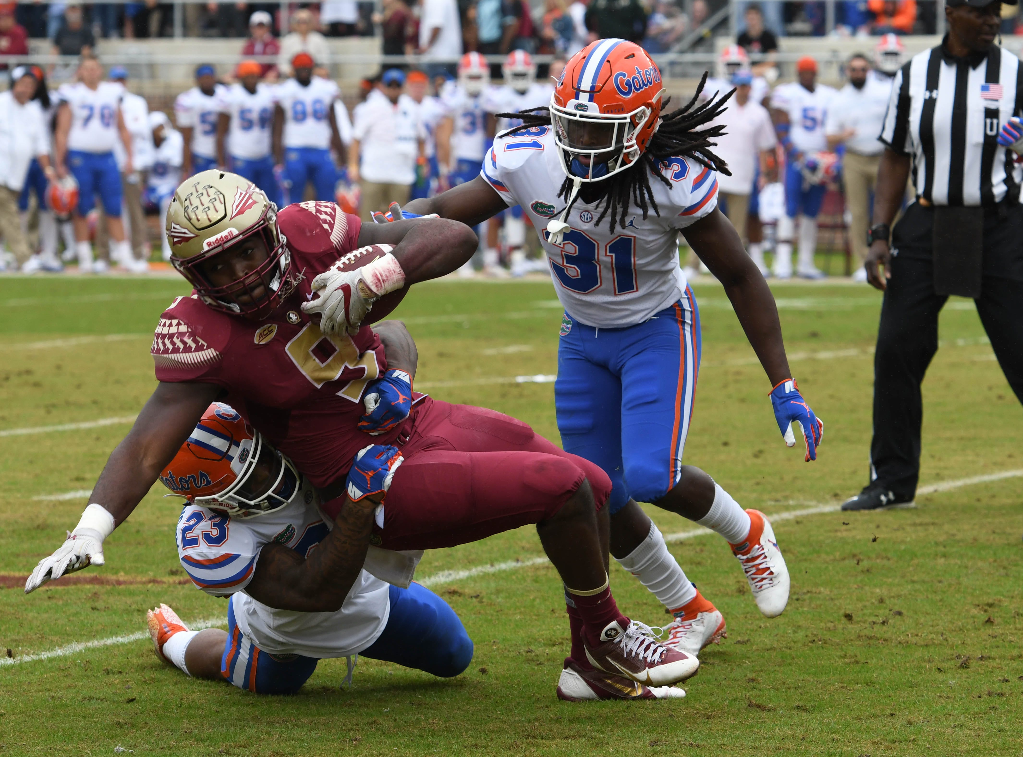 FSU senior runnning back Jacques Patrick (9) gaining a first down in the first quarter of the the FSU game against UF at Doak Campbell Stadium on Novemeber 24, 2018.