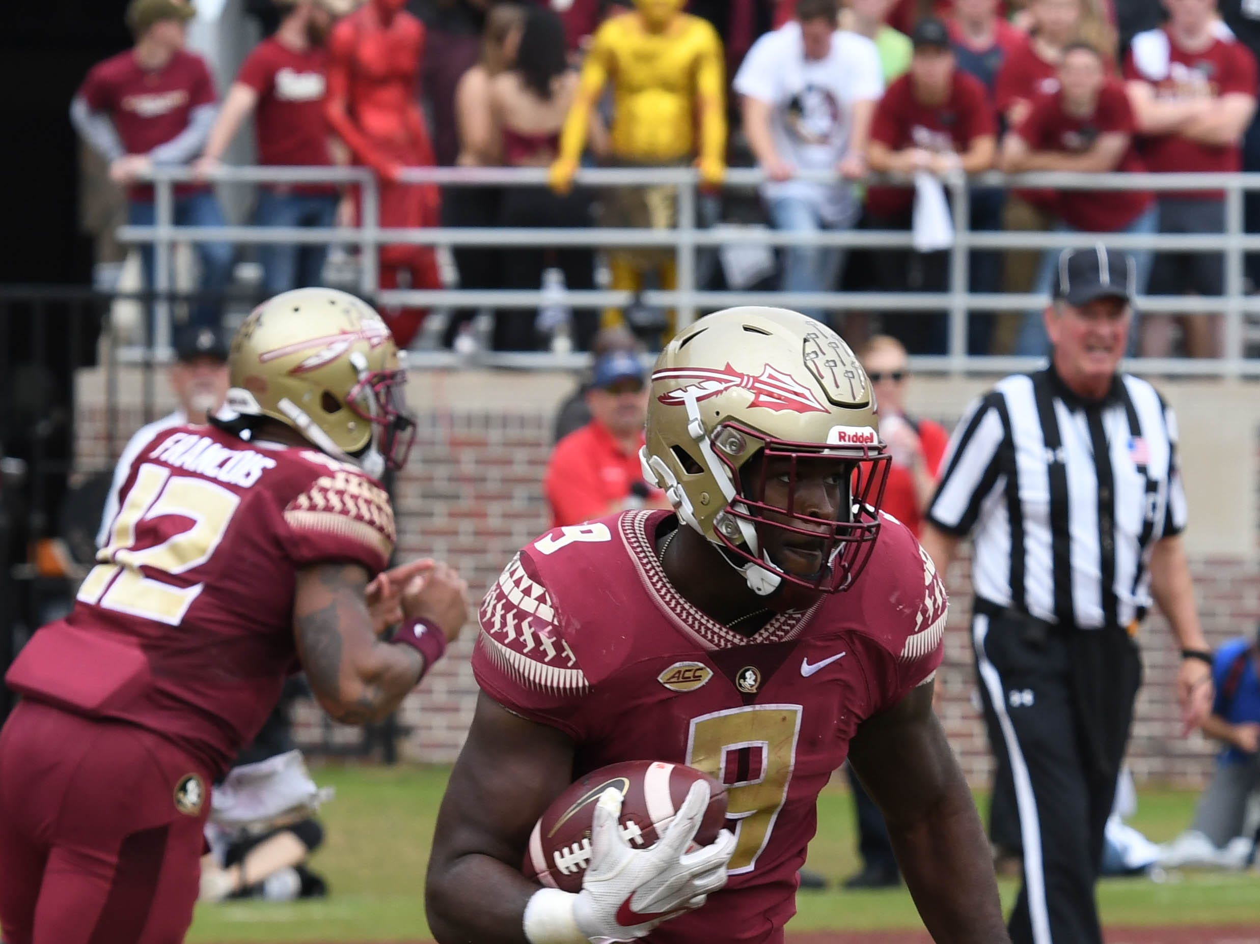 FSU senior runnning back Jacques Patrick (9) running to the outside in the first quarter of the the FSU game against UF at Doak Campbell Stadium on Novemeber 24, 2018.