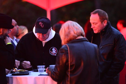 Florida State University President John Thrasher, second from left, and Jeff Binkley, father of Hot Yoga shooting victim Maura Binkley, enjoy a meal together at a fundraiser hosted at the President's house on Monday.