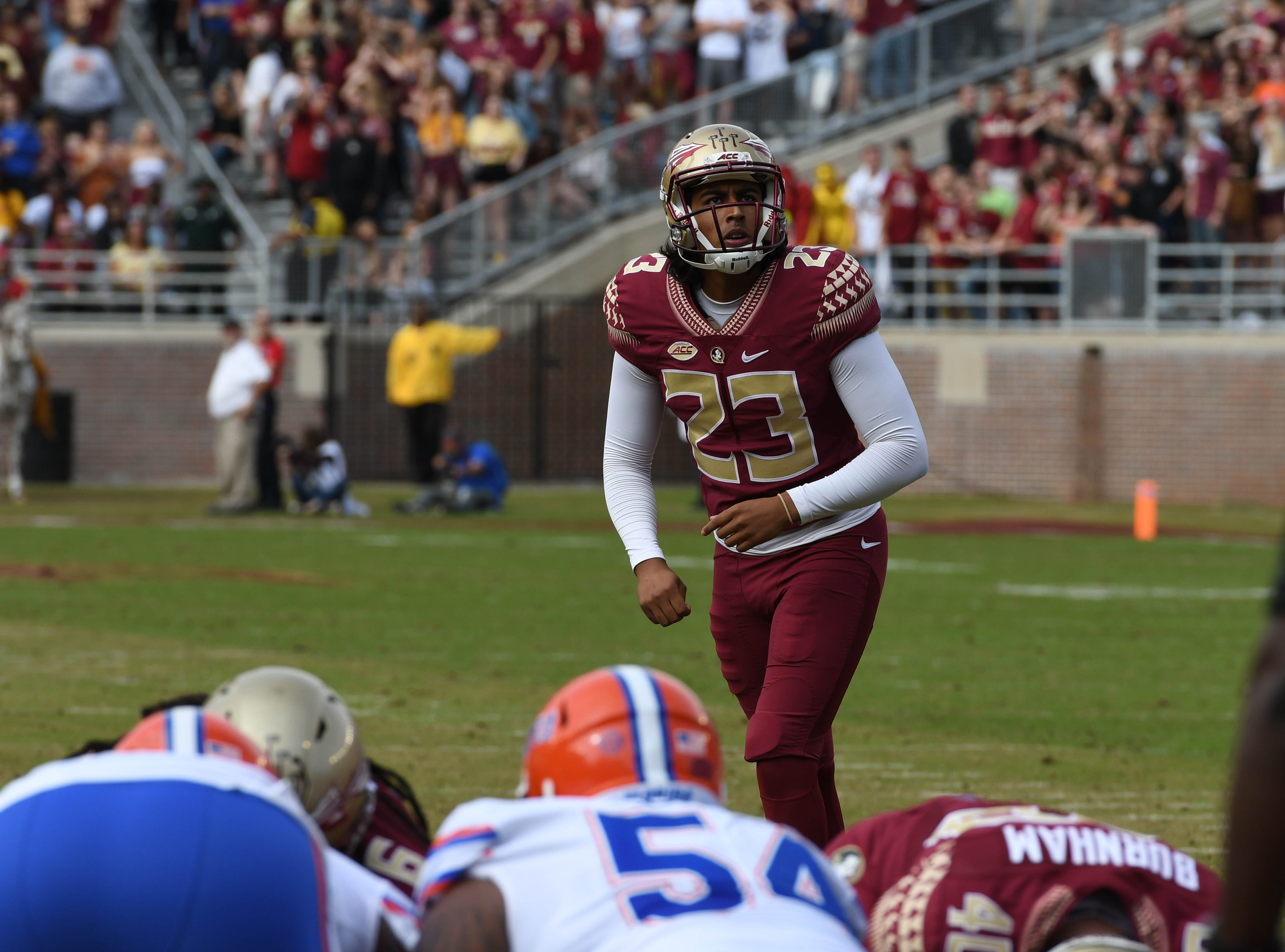 FSU junior kicker Ricky Aguayo (23) kicking an extra point in the second quarter of the FSU game against UF at Doak Campbell Stadium on Novemeber 24, 2018.
