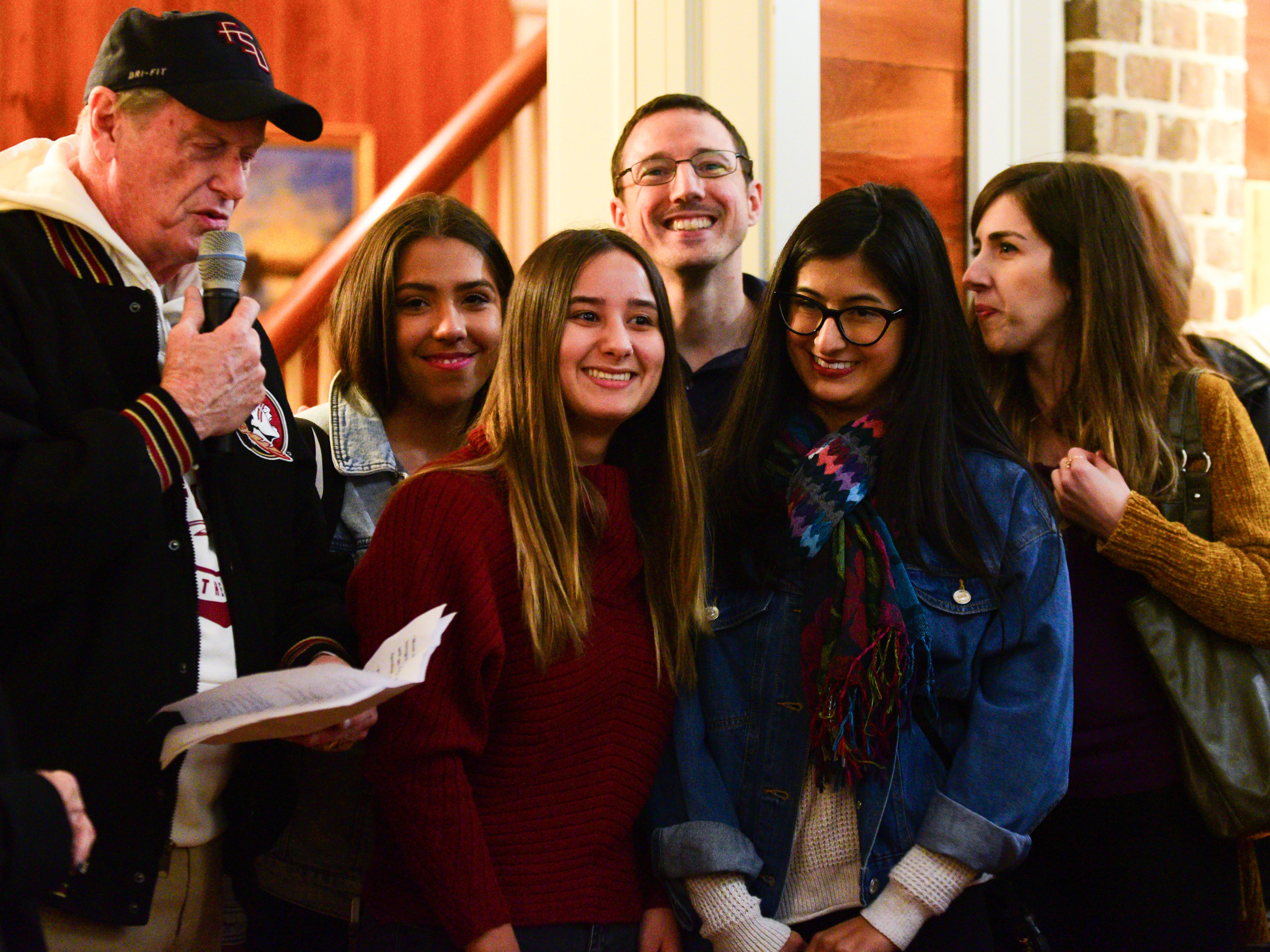 Hot Yoga shooting survivors Sabrina O'Dette, second from left, Daniela Garcia Albalat, center left, Daniela Archila, center right, and Sarah Hodges, right, share a laugh together with Josh Quick, center, and FSU President John Thrasher, right, at the President's House Monday night.