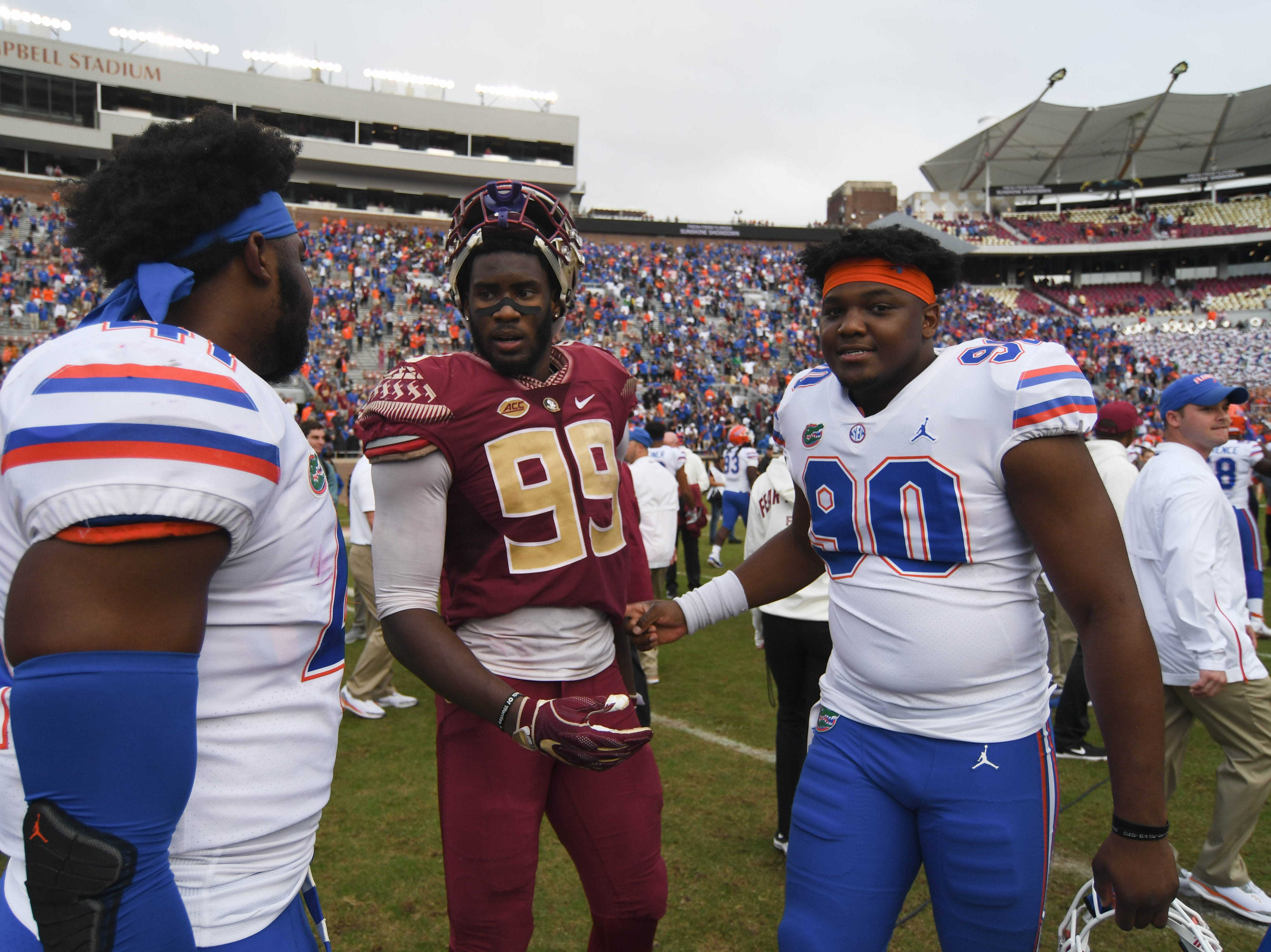 FSU junior defensive end Brian Burns (99) with some UF players after the FSU 41-14 loss to the Gators on November 24, 2018.