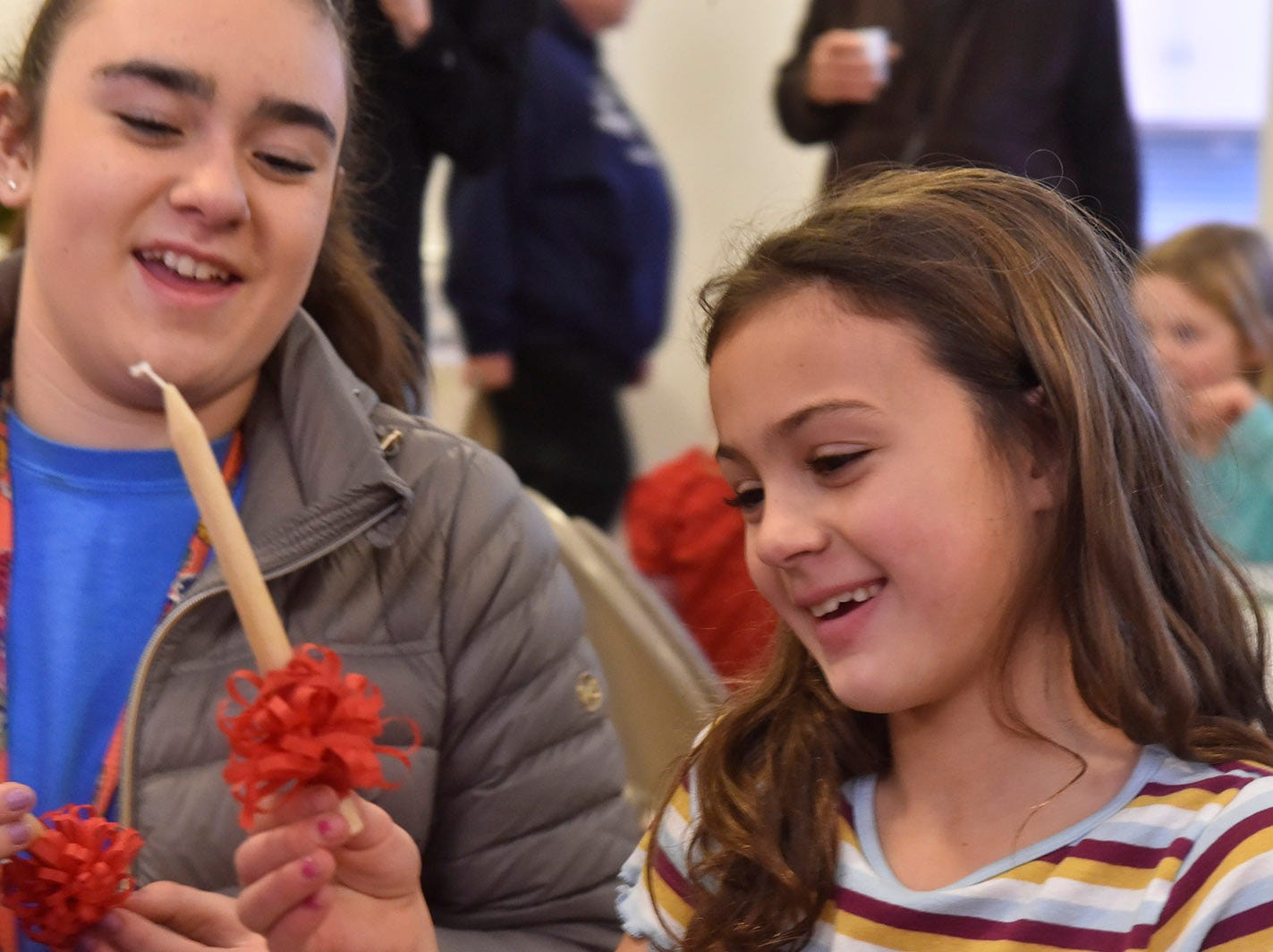 Zoie and Paizley Gill, both of Appleton, learn how to assemble Advent candles at the Ephraim Moravian Church's ADVENTure program during Christmas in the Village in Ephraim on Saturday, Dec. 1, 2018. Tina M. Gohr/USA TODAY NETWORK-Wisconsin