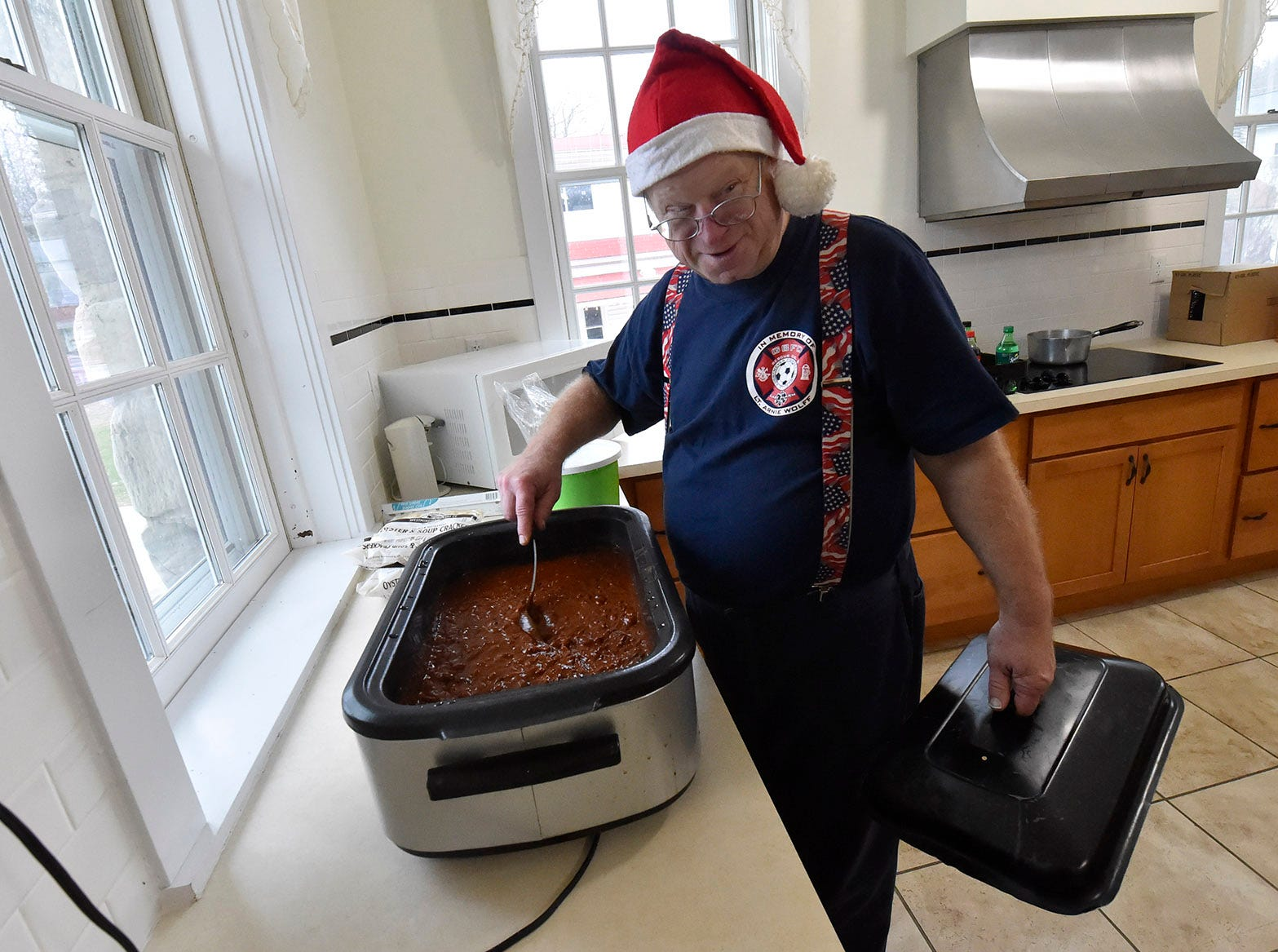 Scotty Weborg of Ephraim keeps an eye on the fund-raising chili donated by The Chef's Hat of Ephraim during Christmas in the Village in Ephraim on Saturday, Dec. 1, 2018. Tina M. Gohr/USA TODAY NETWORK-Wisconsin
