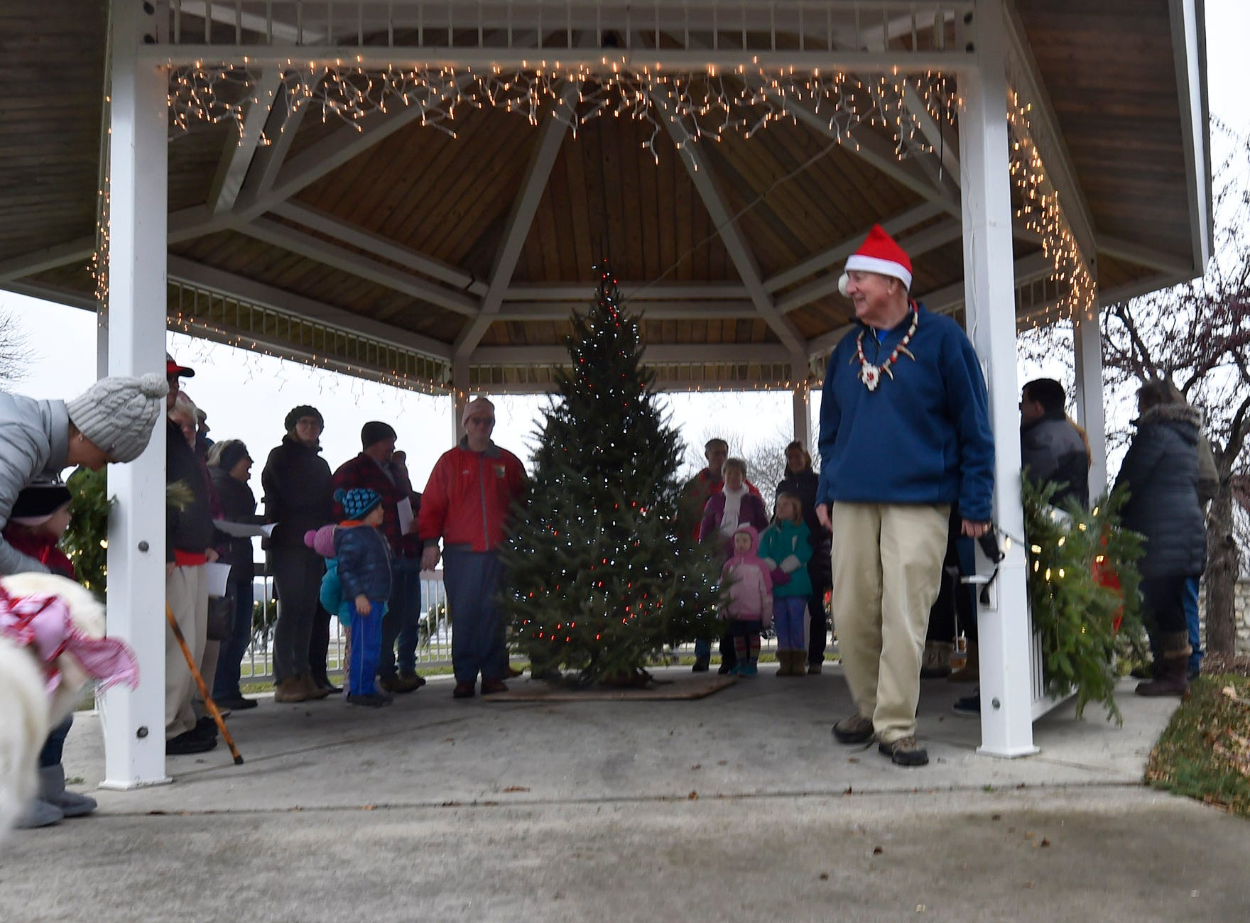 Ephraim's reigning chieftain Tad Dukehart, right, had the honors of flipping the switch for the tree-lighting ceremony at Harborside Park during Christmas in the Village in Ephraim on Saturday, Dec. 1, 2018. Tina M. Gohr/USA TODAY NETWORK-Wisconsin